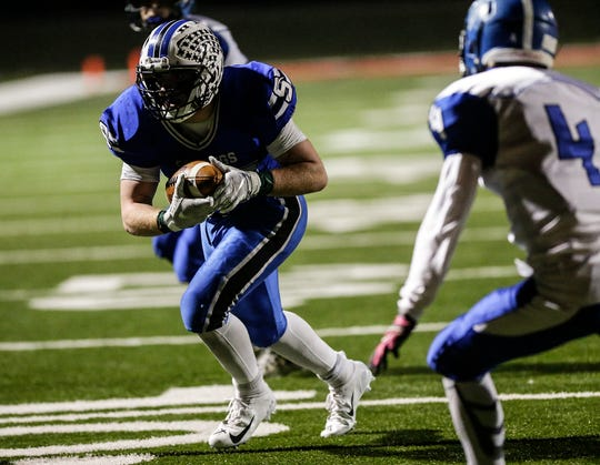St. Mary's Springs' Marcus Orlandoni runs 11 yards for a touchdown against Amherst during a WIAA Division 5 quarterfinal playoff game Friday in Lomira.