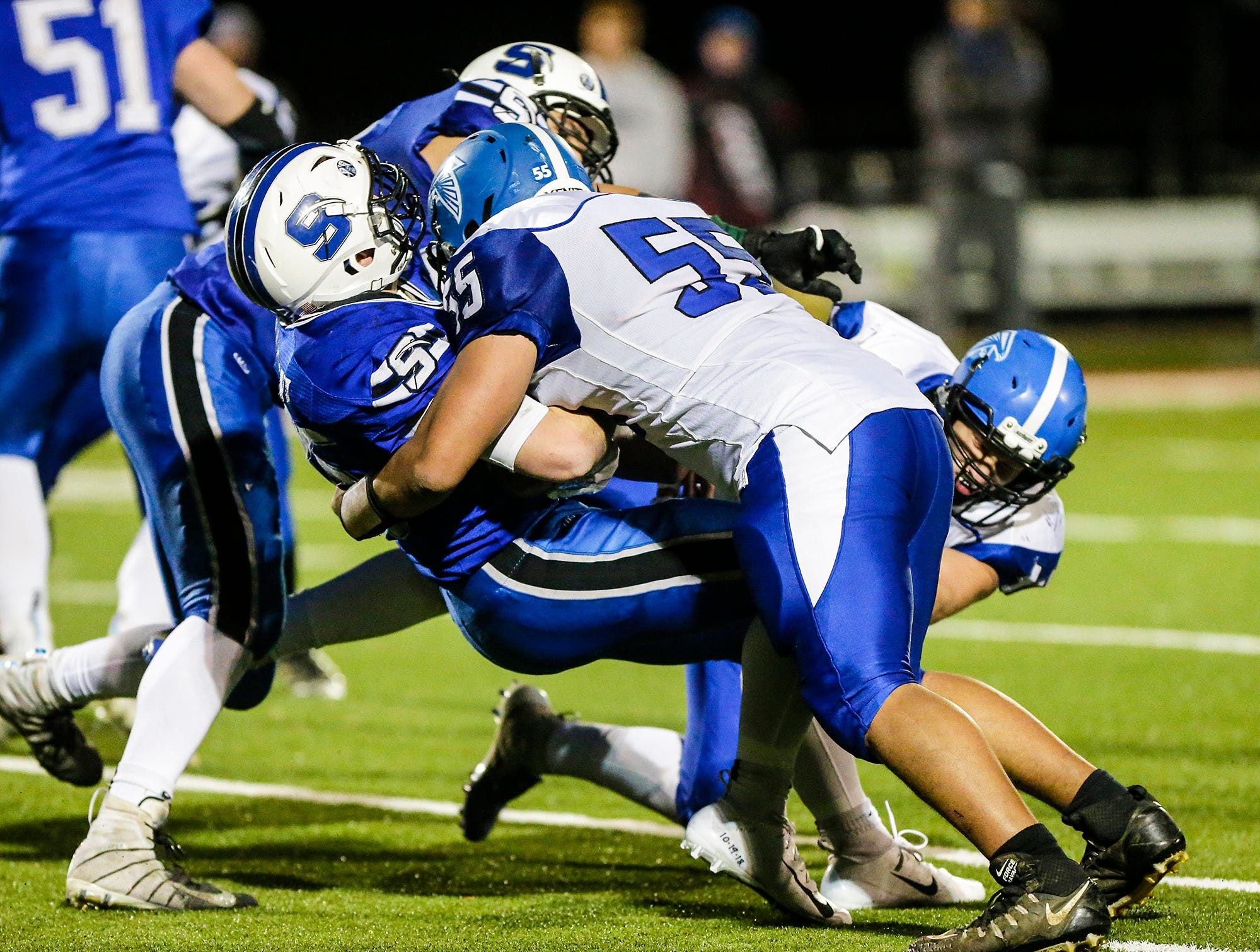 St. Mary's Springs Academy football's Marcus Orlandoni gets tackled by Amherst High School's John Farkas Friday, November 2, 2018 during their WIAA division 5 level 3 playoff game played in Lomira, Wisconsin. Springs won the game 12-0. Doug Raflik/USA TODAY NETWORK-Wisconsin