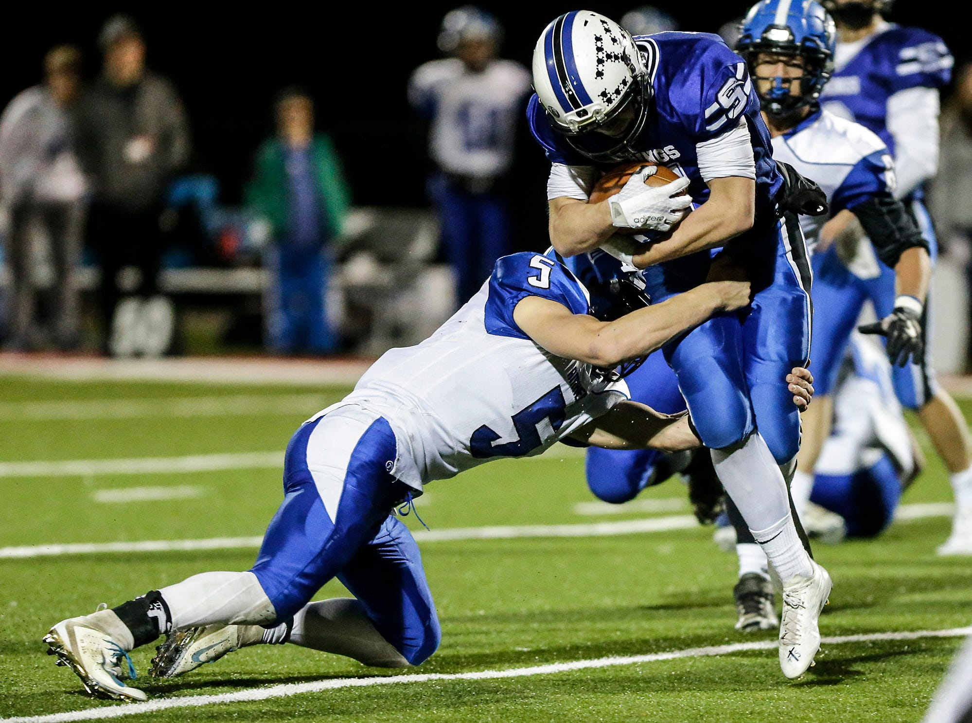 St. Mary's Springs Academy football's Steve Hoepfner runs the ball against Amherst High School's Josh Rieck Friday, November 2, 2018 during their WIAA division 5 level 3 playoff game played in Lomira, Wisconsin. Springs won the game 12-0. Doug Raflik/USA TODAY NETWORK-Wisconsin