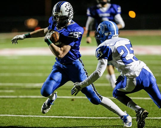 St. Mary's Springs' Jake Hoch runs the football against Amherst during a WIAA playoff game.