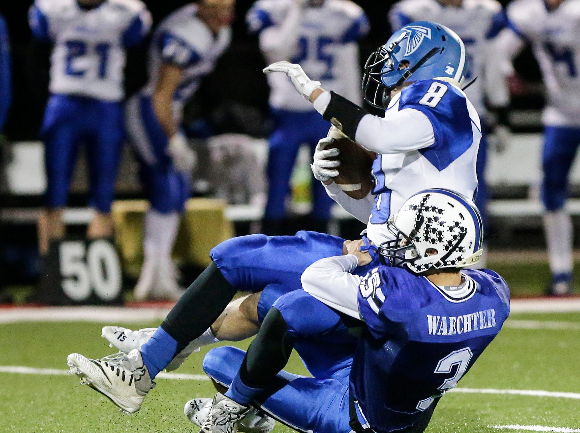 St. Mary's Springs Academy football's Mitchell Waechter tackles Amherst High School's Zach Toelle Friday, November 2, 2018 during their WIAA division 5 level 3 playoff game played in Lomira, Wisconsin. Springs won the game 12-0. Doug Raflik/USA TODAY NETWORK-Wisconsin