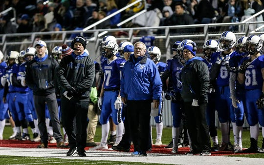 St. Mary's Springs players and coaches look on during their WIAA Division 5 quarterfinal playoff game against Amherst on Friday in Lomira.