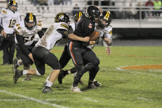 Gibsonburg's Brad Mendoza carries the football against Fairview.