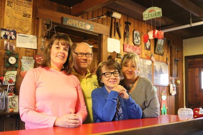 Stacie Lowery, Steve Schmitz, Barbara Schmitz and Debbie Schmitz, of Schmitz Cider Mill, pressed and served up their last batch of apple cider, a local favorite, on Saturday.