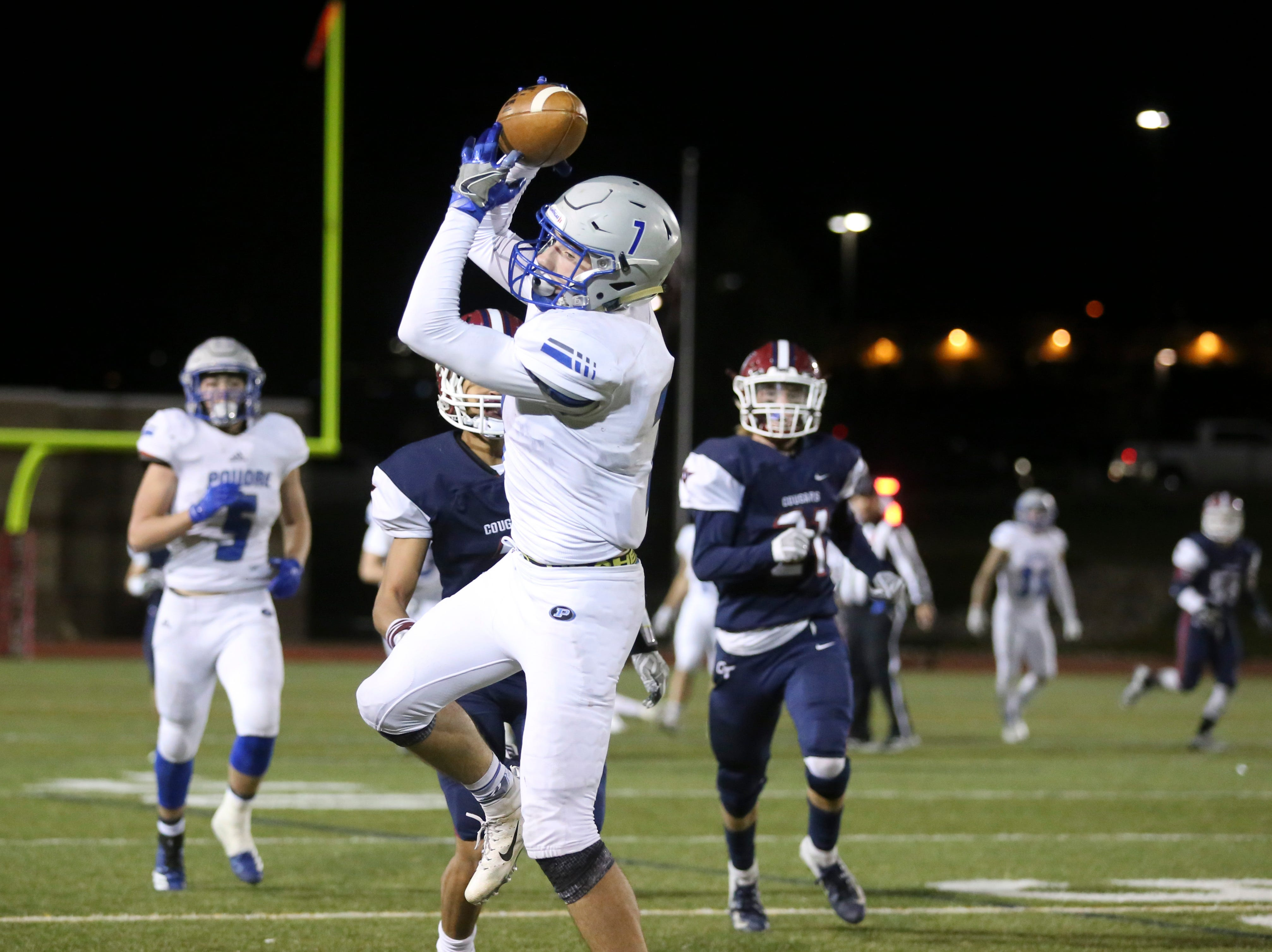 Poudre High School's Josiah Stribling catches a pass against Cherokee Trail High School on Friday evening in Aurora.