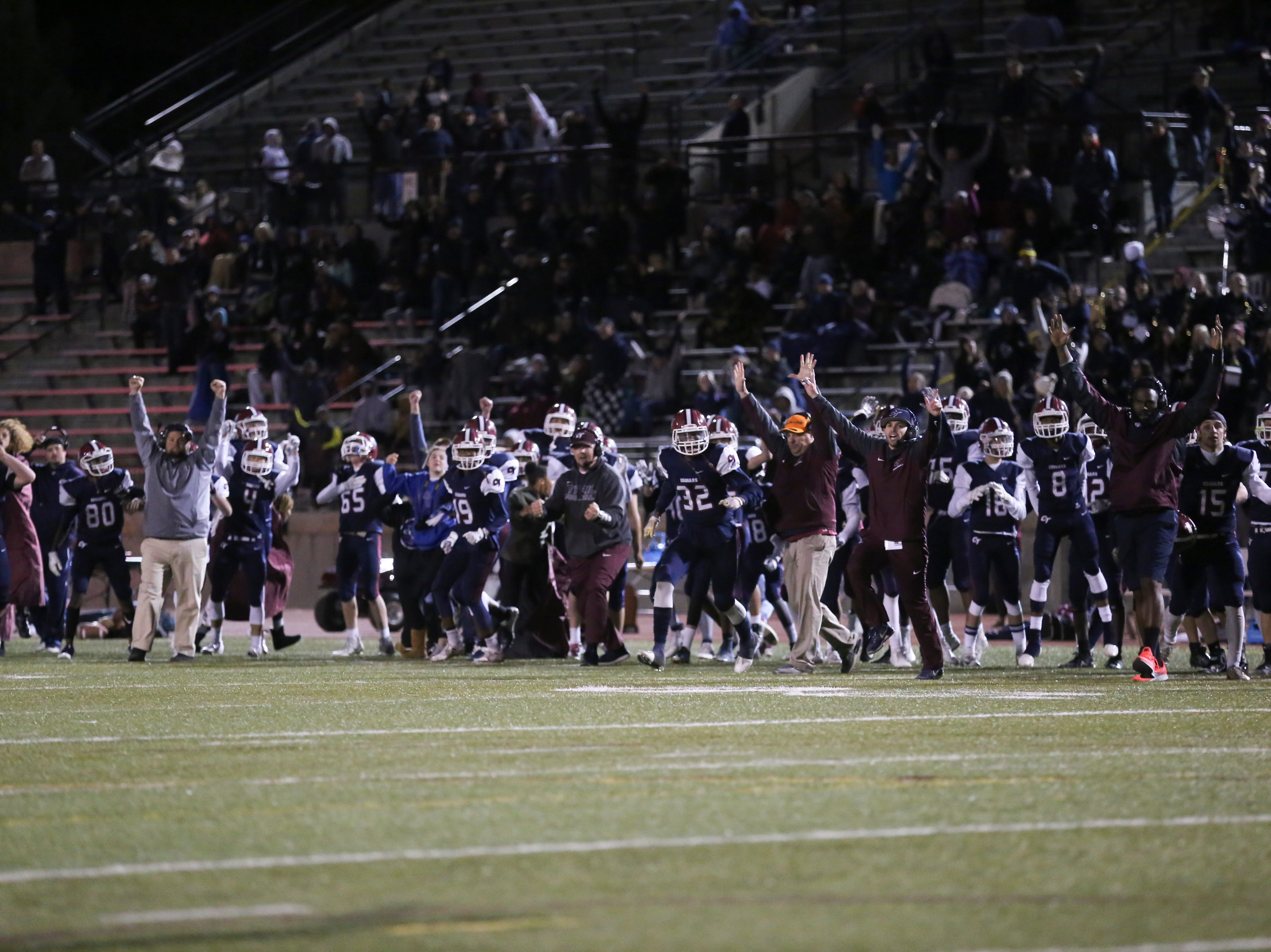 Cherokee Trail High School celebrates after defeating Poudre High School in a double overtime playoff game on Friday evening.
