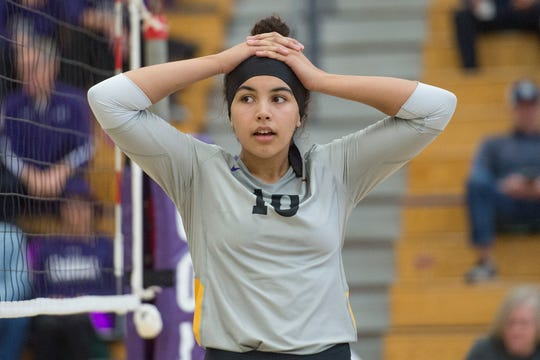 Fort Collins High School's Trinity Corney, shown reacting to a call in a regional playoff game against Grandview Nov. 3, 2018, used her contacts from high school and club volleyball to earn a scholarship offer to play in college at Wyoming.