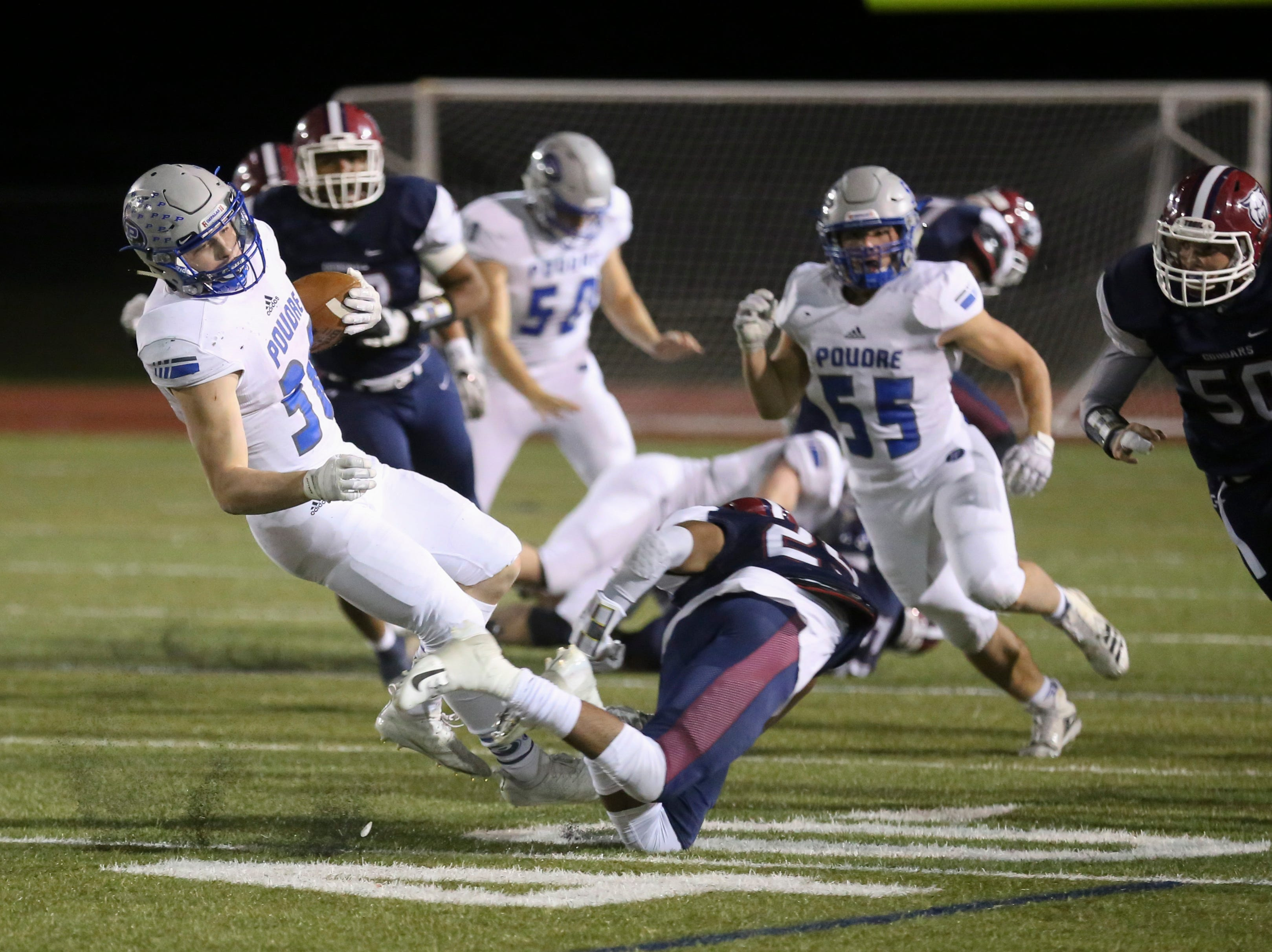 Poudre High School's Tate Satterfield gets tackled by Cherokee Trail High School's Marc-anthony Wingo during a playoff game on Friday evening.