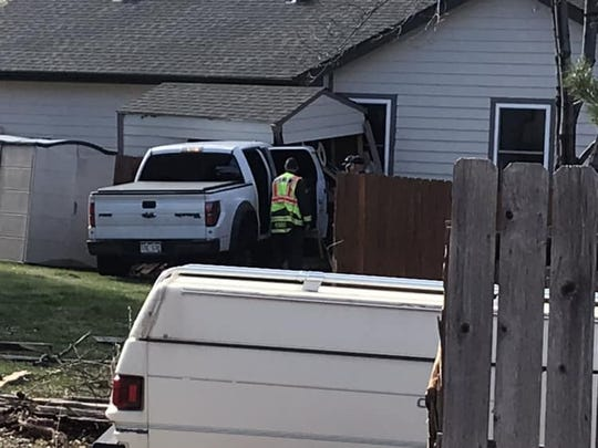A white pickup truck crashed through two Fort Collins backyards on Saturday morning.