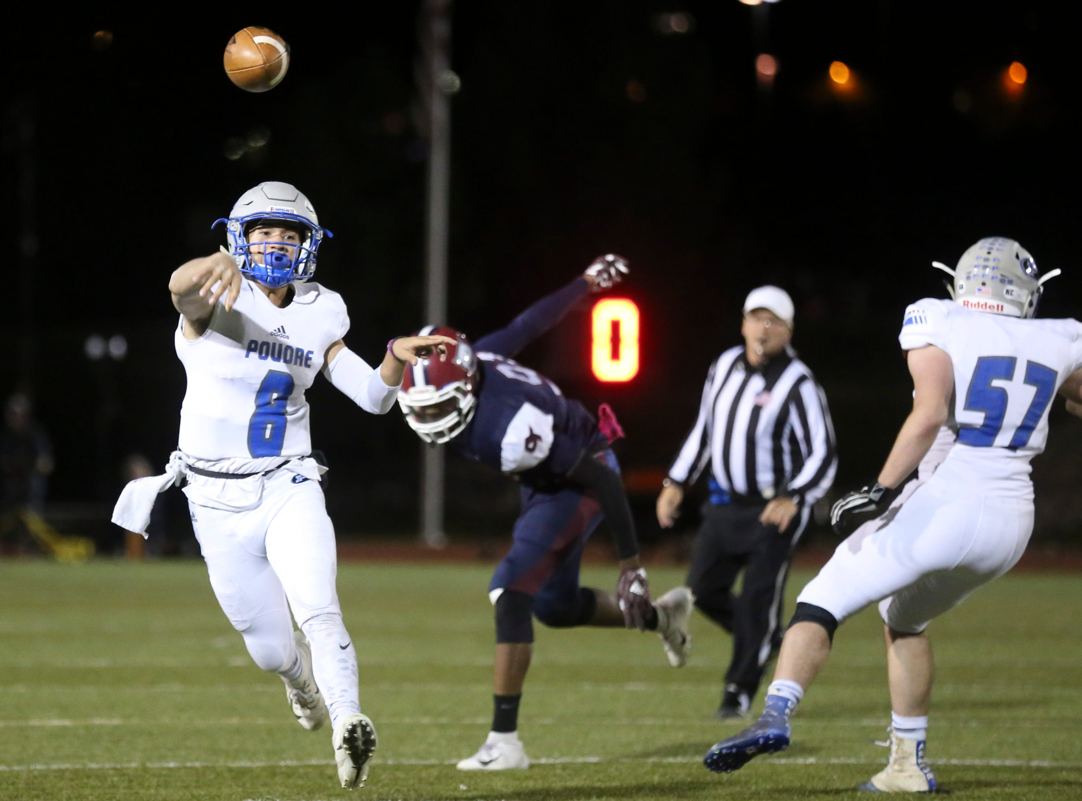 Poudre High School's Sergio Tarango passes the ball against Cherokee Trail High School during their opening round playoff game in Aurora.