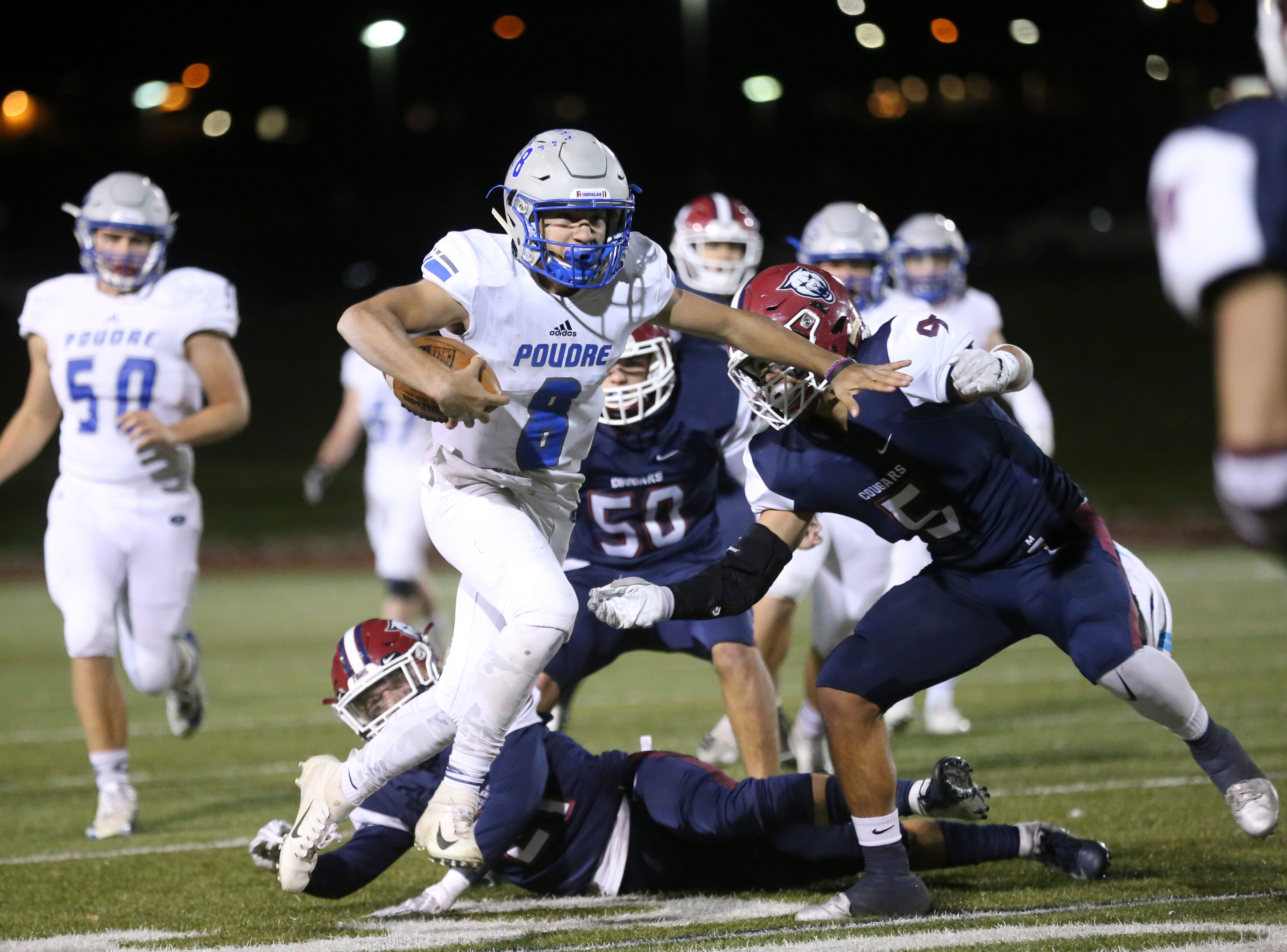 Poudre High School's Sergio Tarango runs the ball against Cherokee Trail High School during Poudre High School's  opening round playoff game in Aurora.