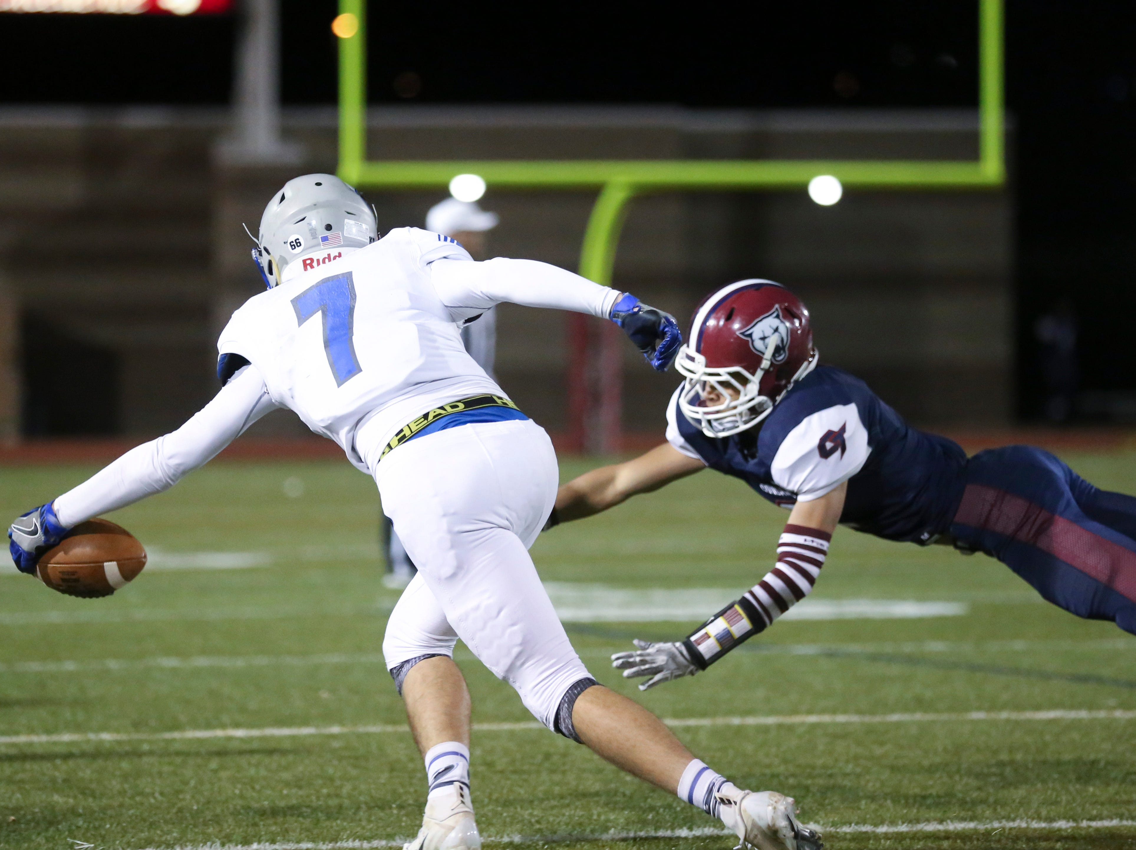 Poudre High School's Josiah Stribling stretches for the ball during the fourth quarter against Cherokee Trail High School on Friday evening.