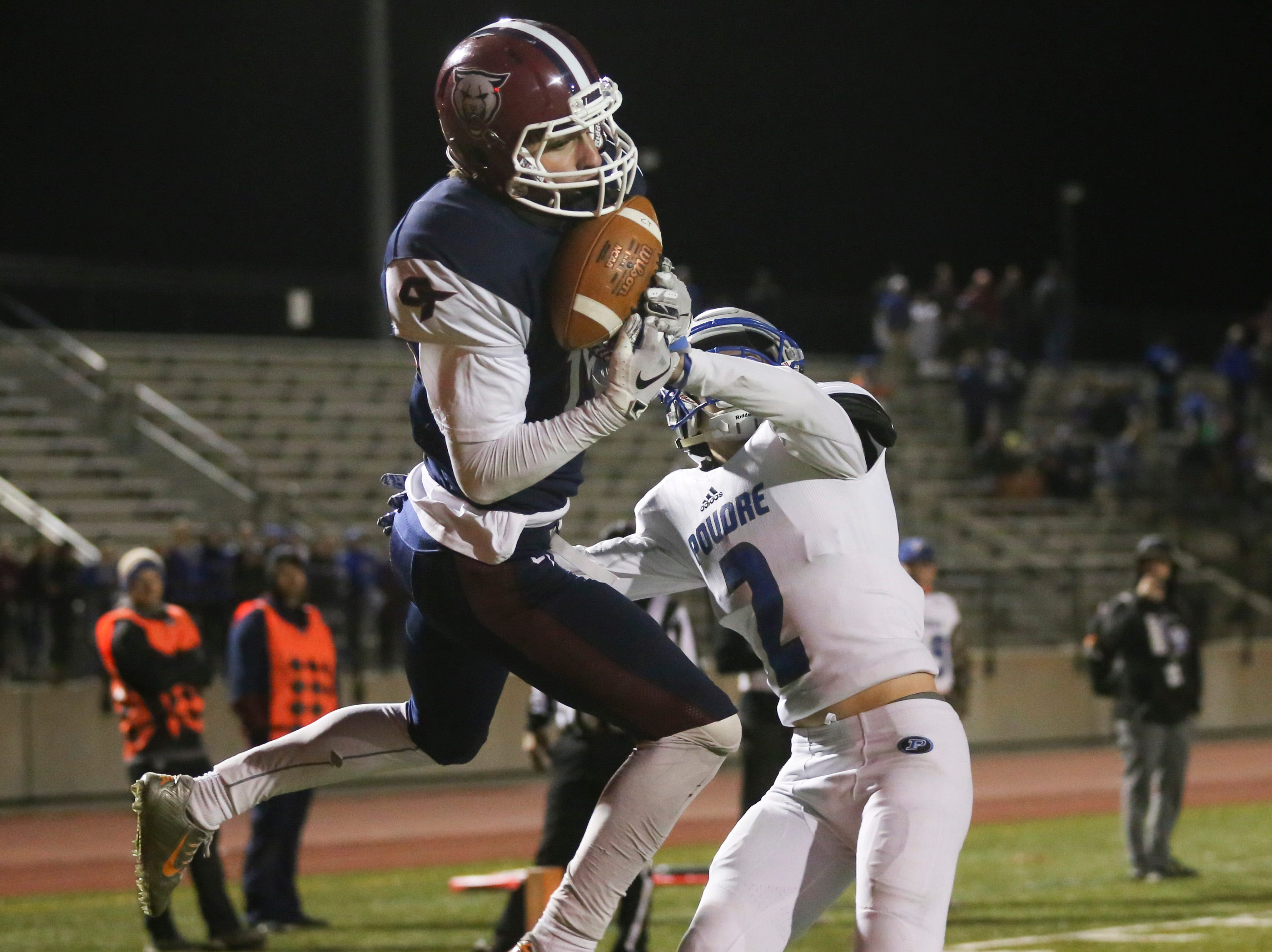 Cherokee Trail High School's Sean Roberts catches a touchdown pass over Poudre High School's Zack Mcvicker during overtime of a state playoff game.