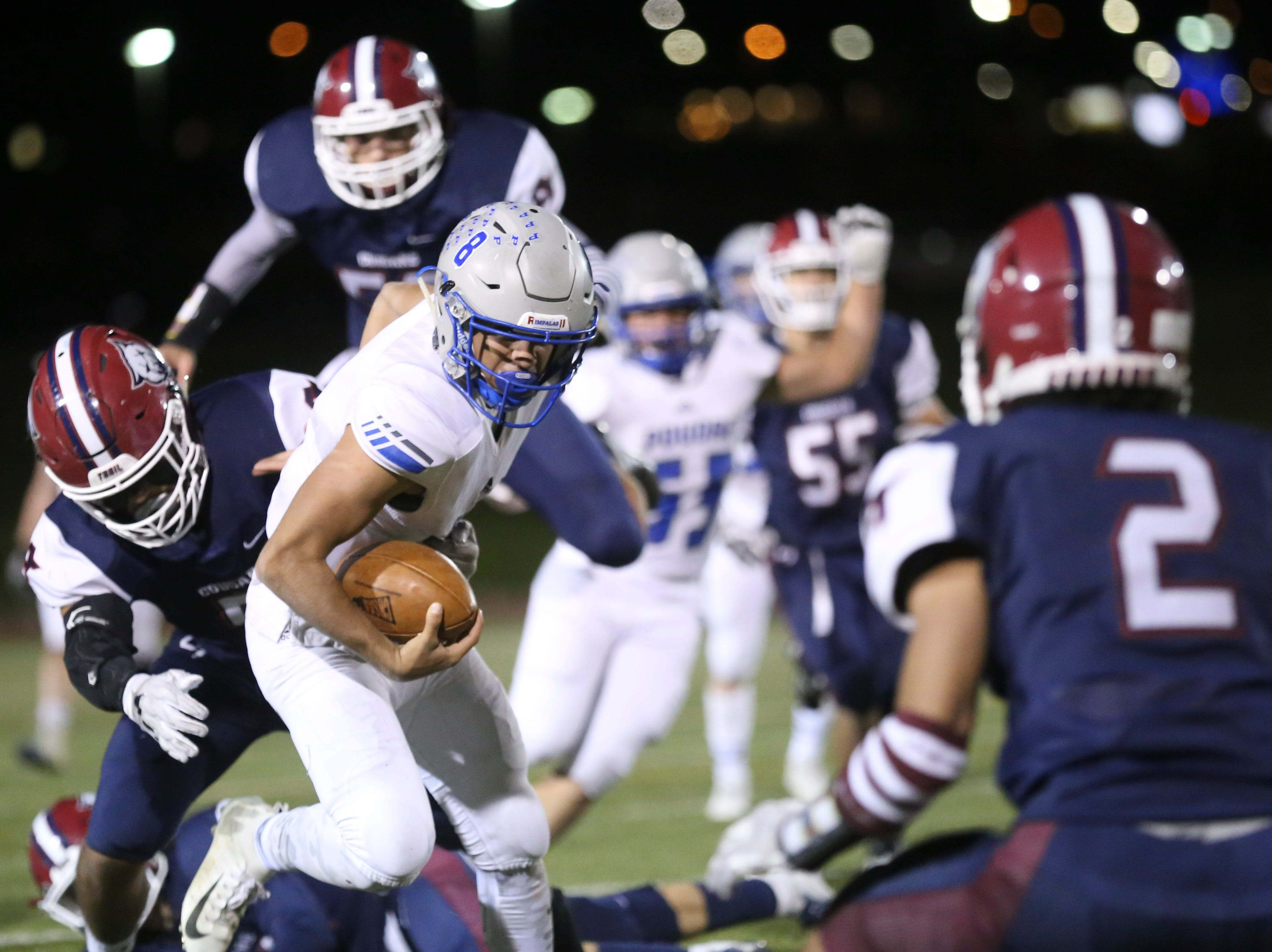 Poudre High School's Sergio Tarango runs the ball against Cherokee Trail High School during his opening round playoff game in Aurora.