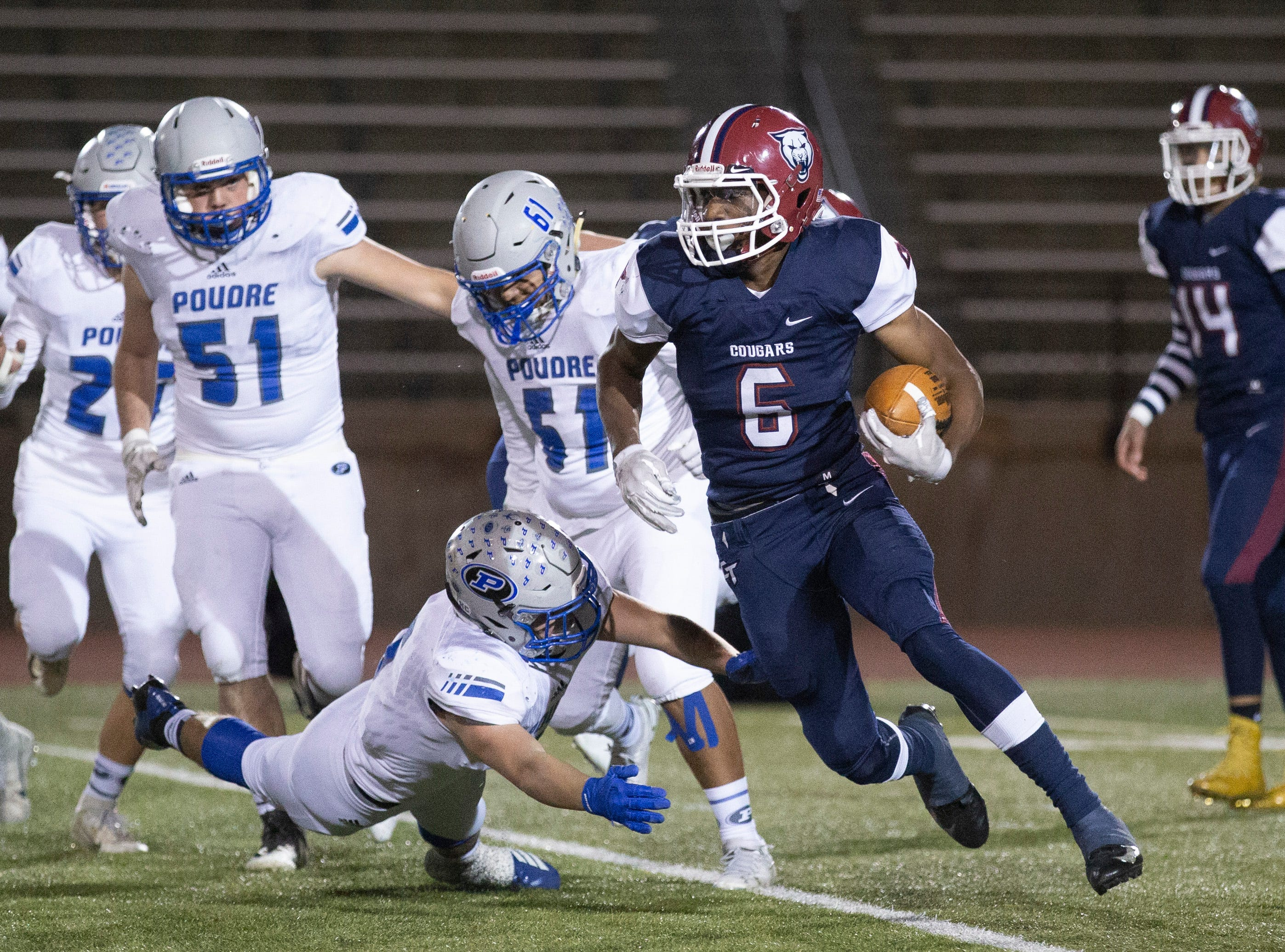 Cherokee Trail High School's Malik Sparrow escapes a tackle from a Poudre High School defender during the first quarter of the opening round playoff game on Friday evening in Aurora.