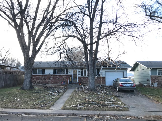 A house on Clover Lane in Fort Collins experienced significant wind damage in Friday's storm.