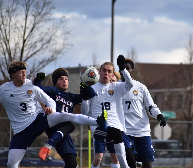 Liberty Common's Tyler Higgins battles a trio of opponents during the Eagles' 1-0 win over Colorado Springs Christian on Saturday at Fossil Ridge High school in the Class 3A state quarterfinals.