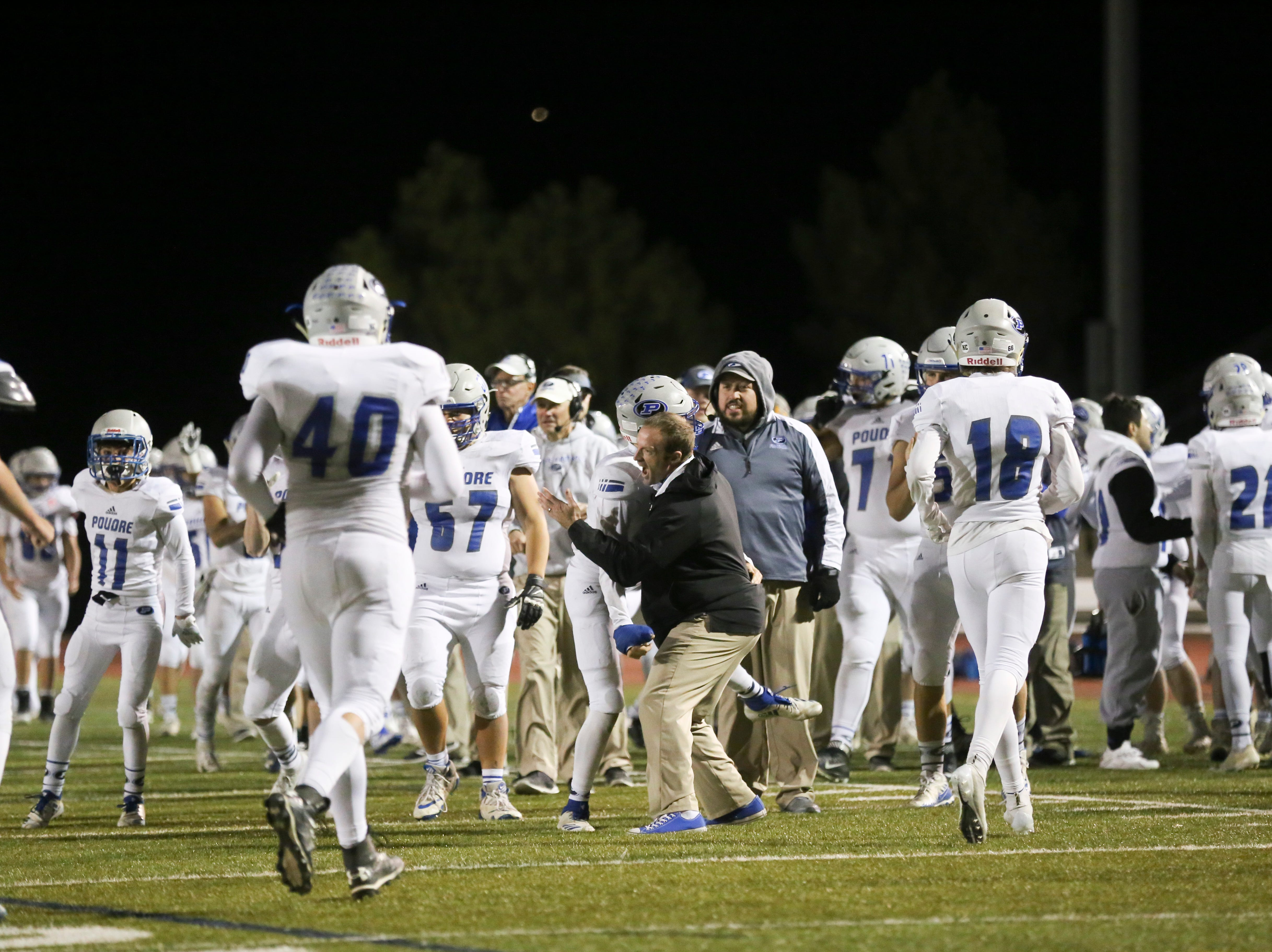 Members of the Poudre High School bench celebrate a goal line stop against Cherokee Trail High School on Friday evening.