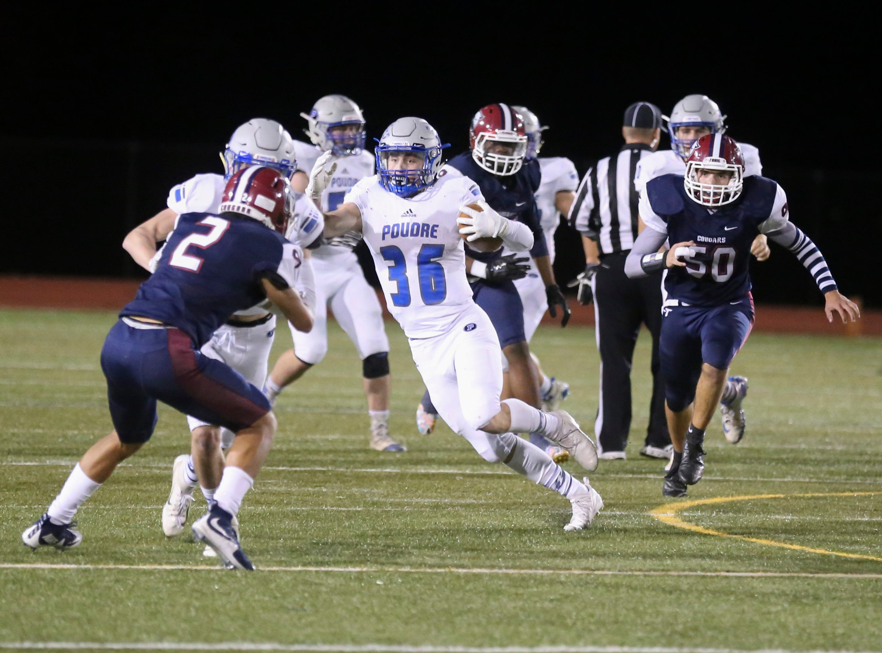 Poudre High School's Tate Satterfield runs the ball during the third quarter against Cherokee Trail High School on Friday evening.