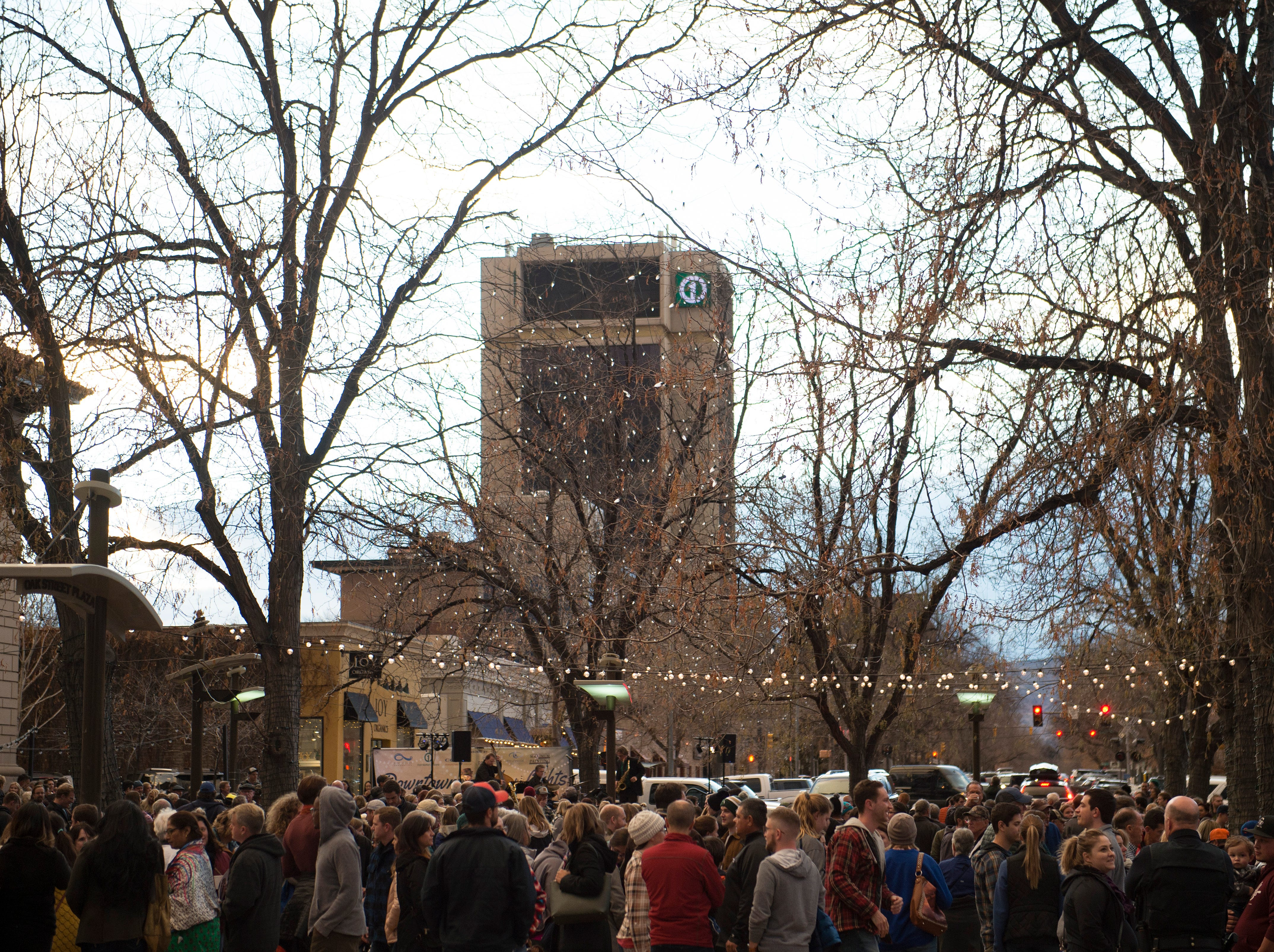 People crowd Oak Street Plaza before the holiday lights turn on in Old Town on Friday, November 2, 2018. The lights will illuminate Old Town until Feb. 14.