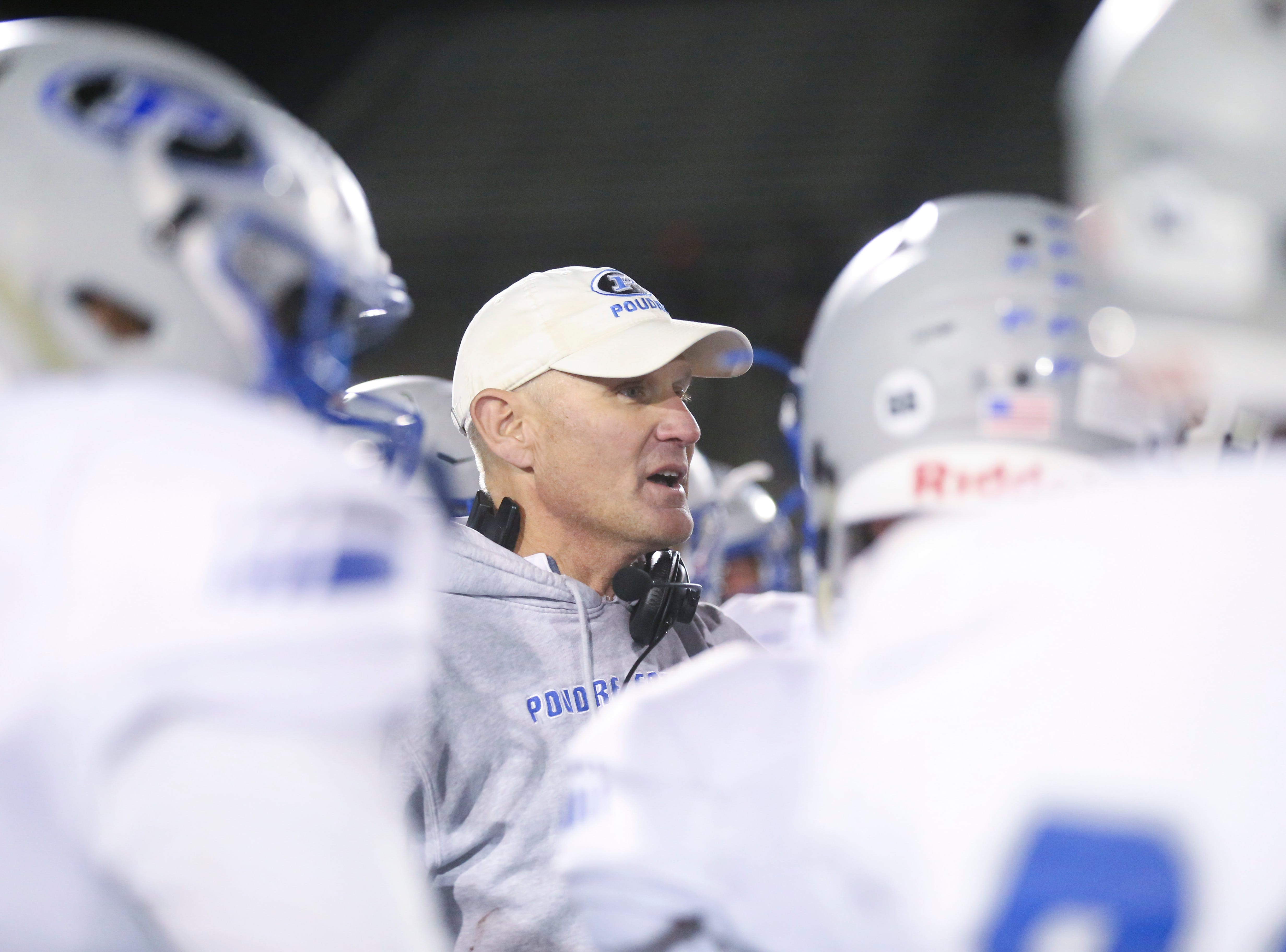 Poudre High School's head coach, Marty McVicker, speaks to his players after being defeated by Cherokee Trail High School in a double overtime state playoff game on Friday evening in Aurora.