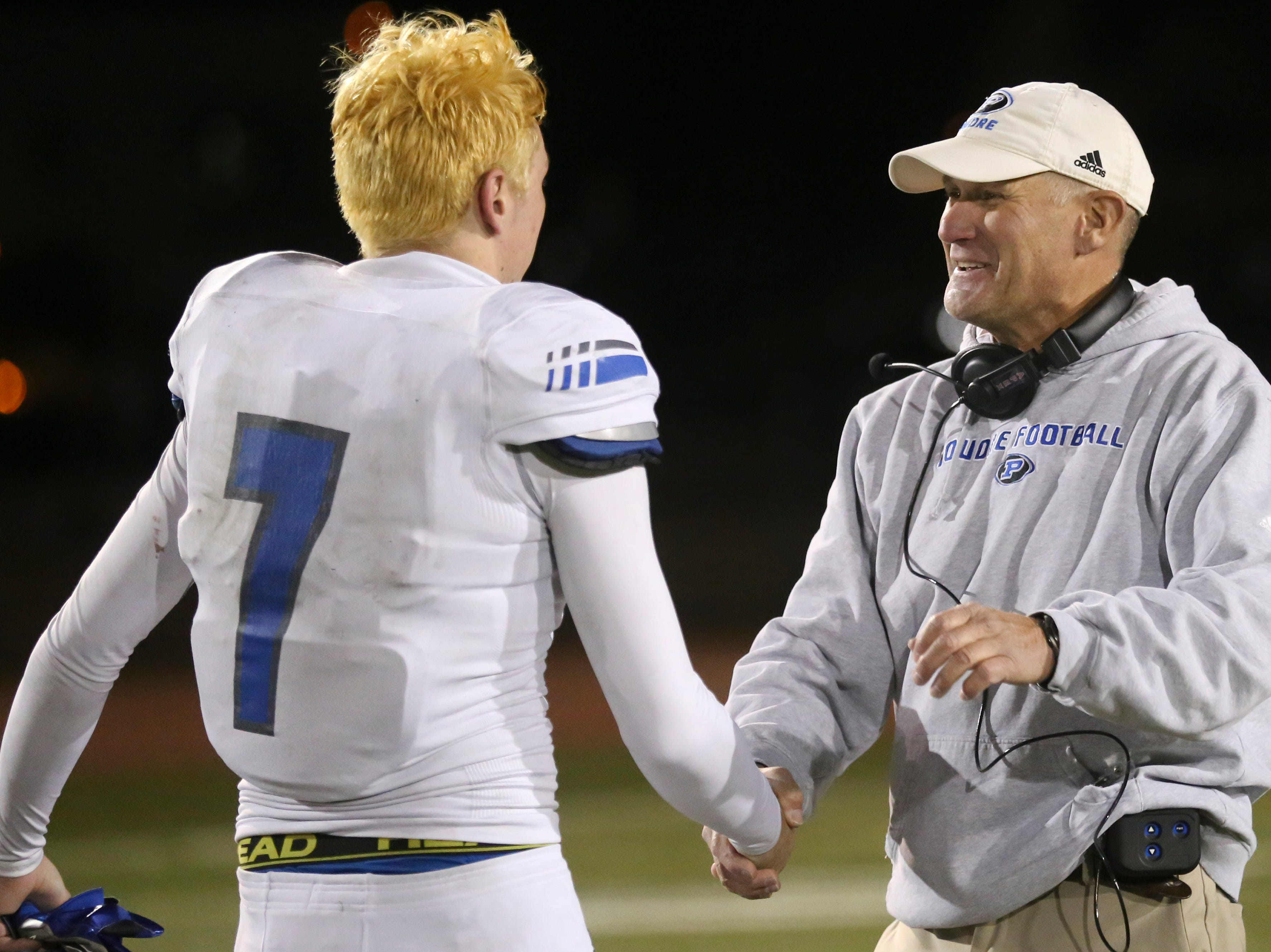 Poudre High School's Josiah Stribling speaks to his head coach, Marty McVicker, after being defeated by Cherokee Trail High School in a double overtime playoff game on Friday evening.