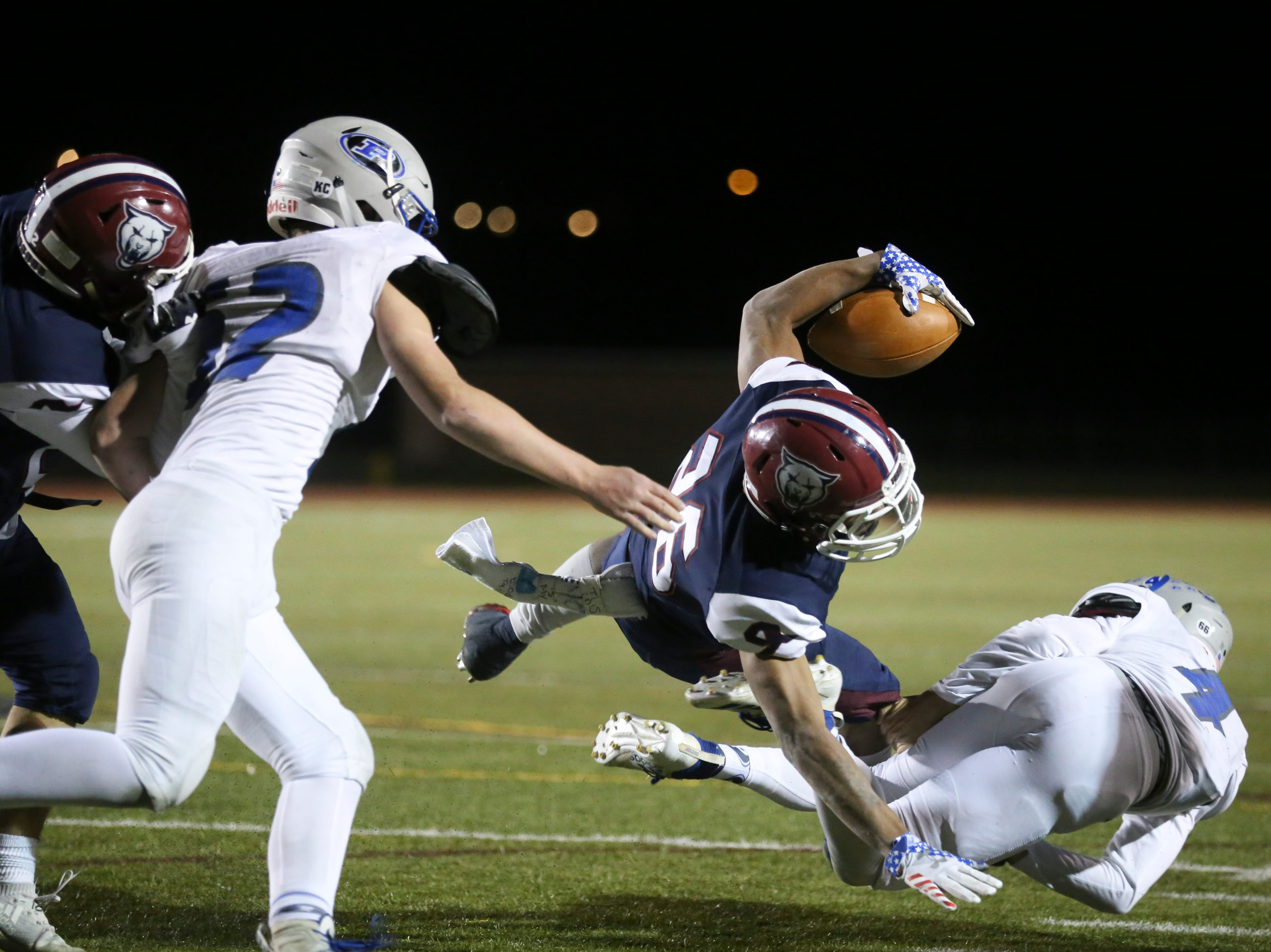 Cherokee Trail High School's Ahmarion Shead dives for the endzone against Poudre High School on Friday evening.