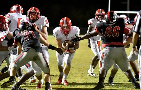 North Fort Myers running back Hunter Kobylanski (3) finds a hole to run the ball in for a touchdown during their game with South Fort Myers High School on Friday, Nov. 2.