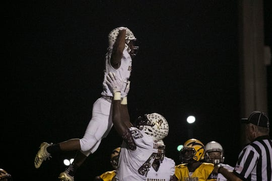 Trevon Dickerson of Riverdale lifts Adarian Robinson in the air after Robinson scored Riverdale's second touchdown in the final regular season game on Friday, November 2, 2018, at Lehigh Senior High School.