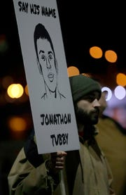 "About 100 people gathered Friday night for the ""Justice for Jonathon Rally"" in downtown Green Bay. The event was organized by Black Lives United-Green Bay and Native Lives Matter after Jonathon Tubby was killed by a Green Bay police officer on Oct. 19, 2018. Sarah Kloepping/USA TODAY NETWORK-Wisconsin"