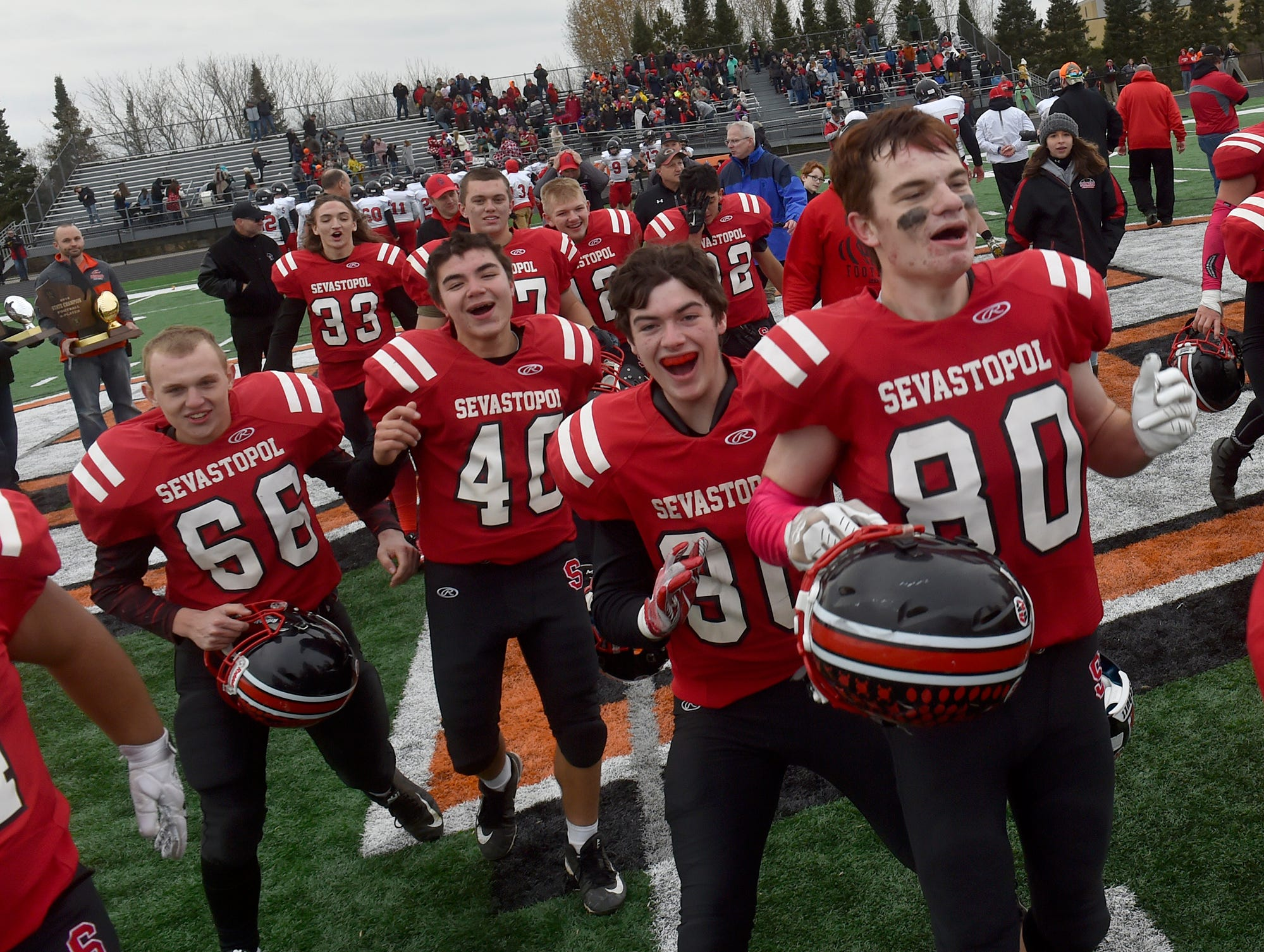 Celebrating the victory against Luck at the WIAA 8-Player State Championship game at Stanley-Boyd High School on Nov. 3, 2018. Tina M. Gohr/USA TODAY NETWORK-Wisconsin