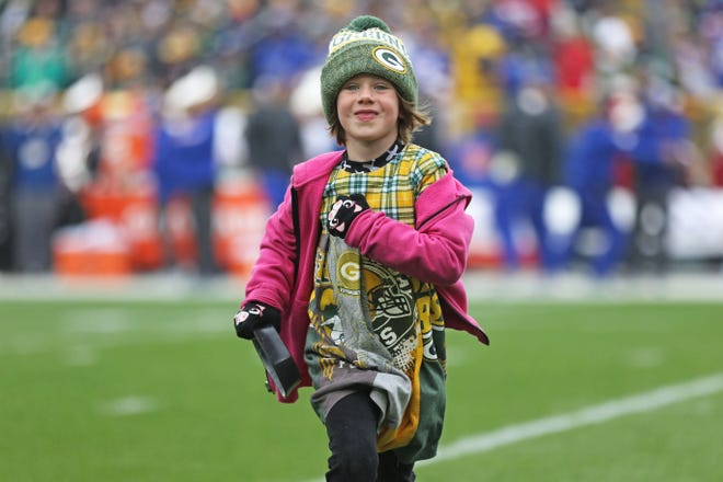 Octavia Burkhart, 6, of Sobieski, retrieves the kicking tee from the field at the Sept. 30 Green Bay Packers home game against the Buffalo Bills.