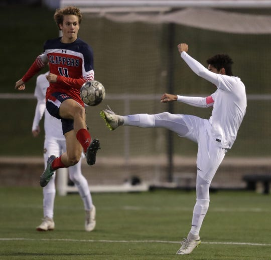 Sturgeon Bay High School's Nathaniel Greenlaw (11) goes up against University School of Milwaukee's Ethan Ford (9) during their WIAA Division 4 state semifinal boys soccer game Friday, November 2, 2018, at Uihlein Soccer Park in Milwaukee, Wis.  Dan Powers/USA TODAY NETWORK-Wisconsin
