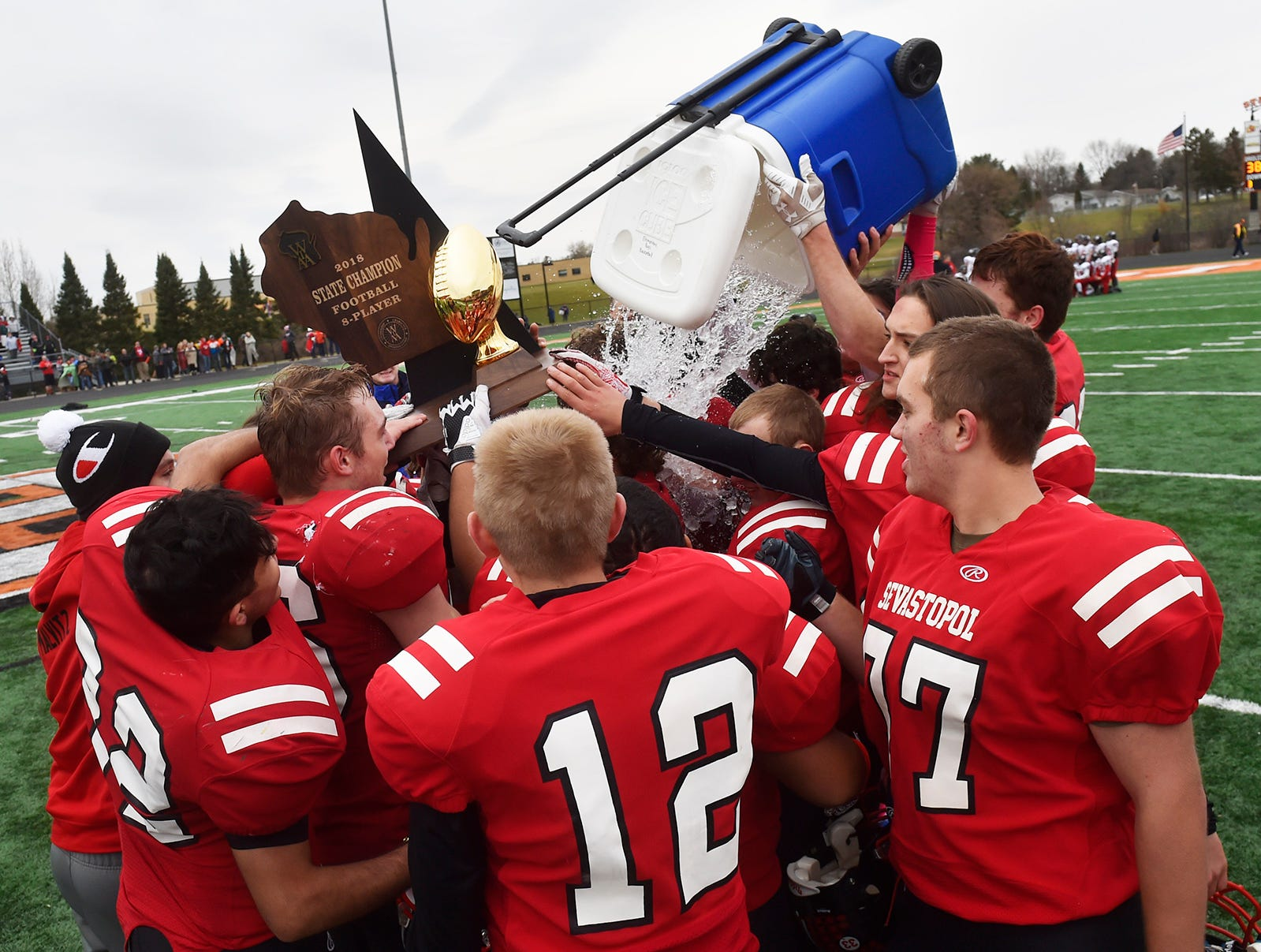 Celebrating the victory at the WIAA 8-Player State Championship game at Stanley-Boyd High School on Nov. 3, 2018. The Sevastopol Pioneers won their first state football title, 38-30. Tina M. Gohr/USA TODAY NETWORK-Wisconsin