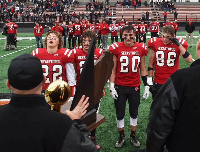 Sevastopol claimed the first WIAA 8-Player Championship state title with a 38-30 victory over Luck on Saturday, Nov. 3, 2018, at Stanley-Boyd High School. Receiving the gold ball on behalf of the team are Nathan Stenzel, from left, Jaden Sawyer, Jeremy Jorns and Max Krohn.