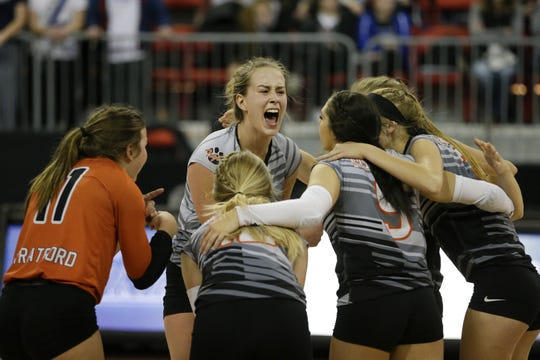 Stratford's Mazie Nagel celebrates a point against Lake Country Lutheran during the WIAA girls state volleyball Division 3 championship match Saturday  at the Resch Center.
