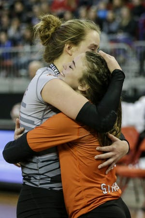 Stratford's Mazie Nagel, left, embraces her libero McKenna Krall after losing to Lake Country Lutheran in the WIAA girls state volleyball Division 3 championship match Saturday at the Resch Center in Ashwaubenon.