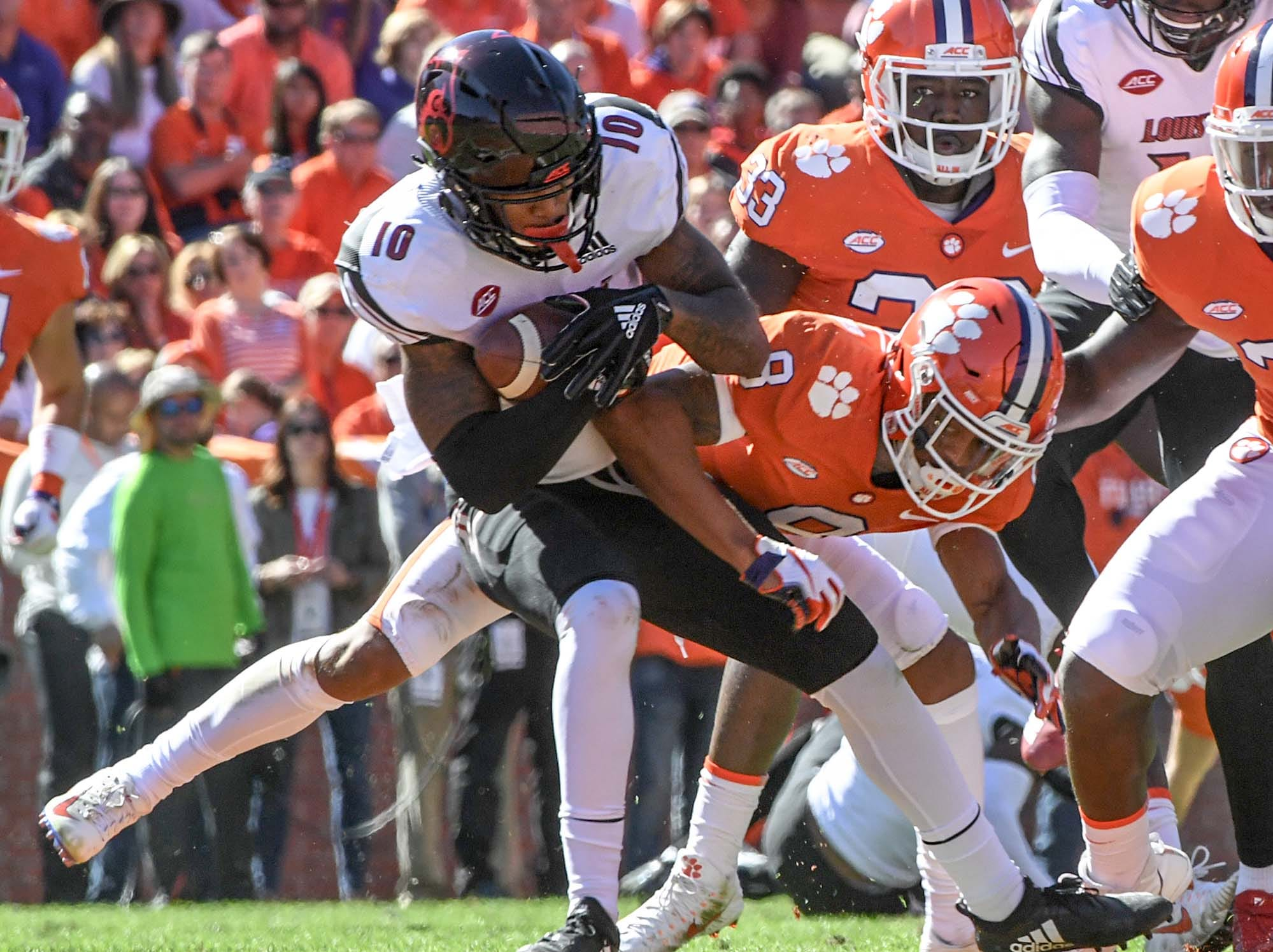 Clemson defensive back A.J. Terrell (8) tackles Louisville running back Javian Hawkins(10) on a punt return play during the second quarter in Memorial Stadium on Saturday, November 3, 2018. Terrell was ejected from the game for targeting.