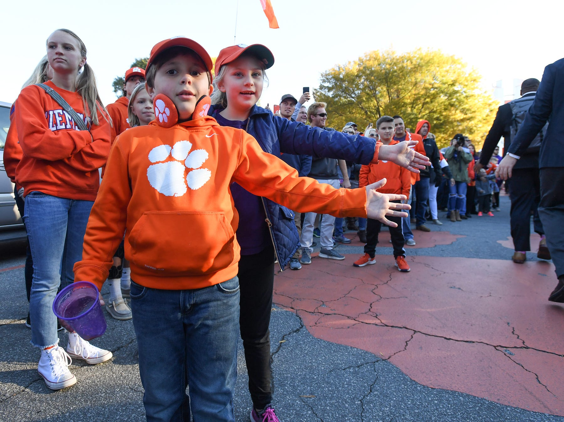 Clemson players and fans take part in Tiger Walk before the Tiger's game against Louisville Saturday, November 3, 2018 at Clemson's Memorial Stadium.