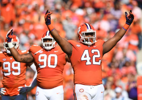 Clemson defensive lineman Christian Wilkins (42) and defensive lineman Dexter Lawrence (90) get the crowd up as the Tigers play Louisville during the 1st quarter Saturday, November 3, 2018 at Clemson's Memorial Stadium.