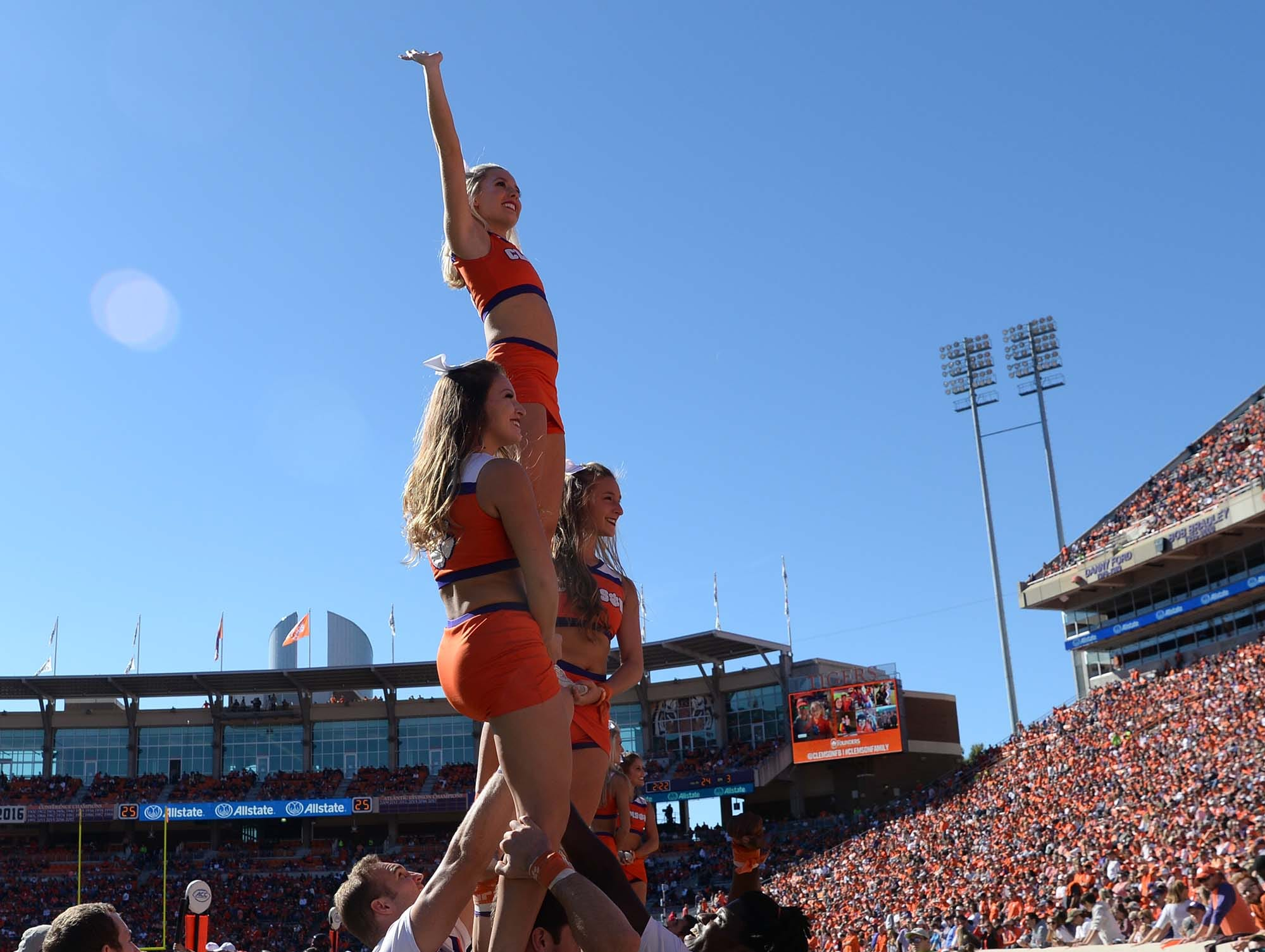 Clemson cheerleaders make a formation as the team plays Louisville during the fourth quarter in Memorial Stadium on Saturday, November 3, 2018.