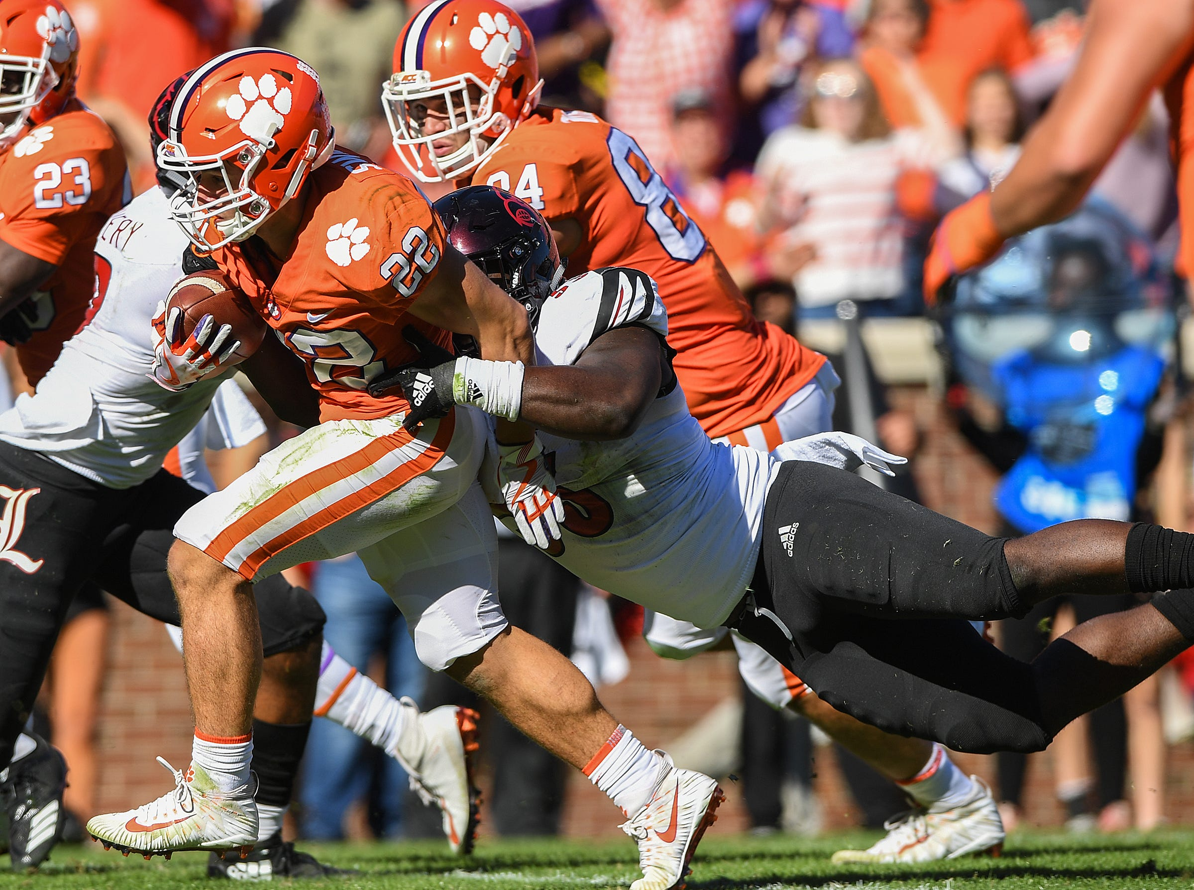 Clemson wide receiver Will Swinney (22) breaks free from Louisville defensive end Amonte Caban (53) to score during the 4th quarter Saturday, November 3, 2018 at Clemson's Memorial Stadium.