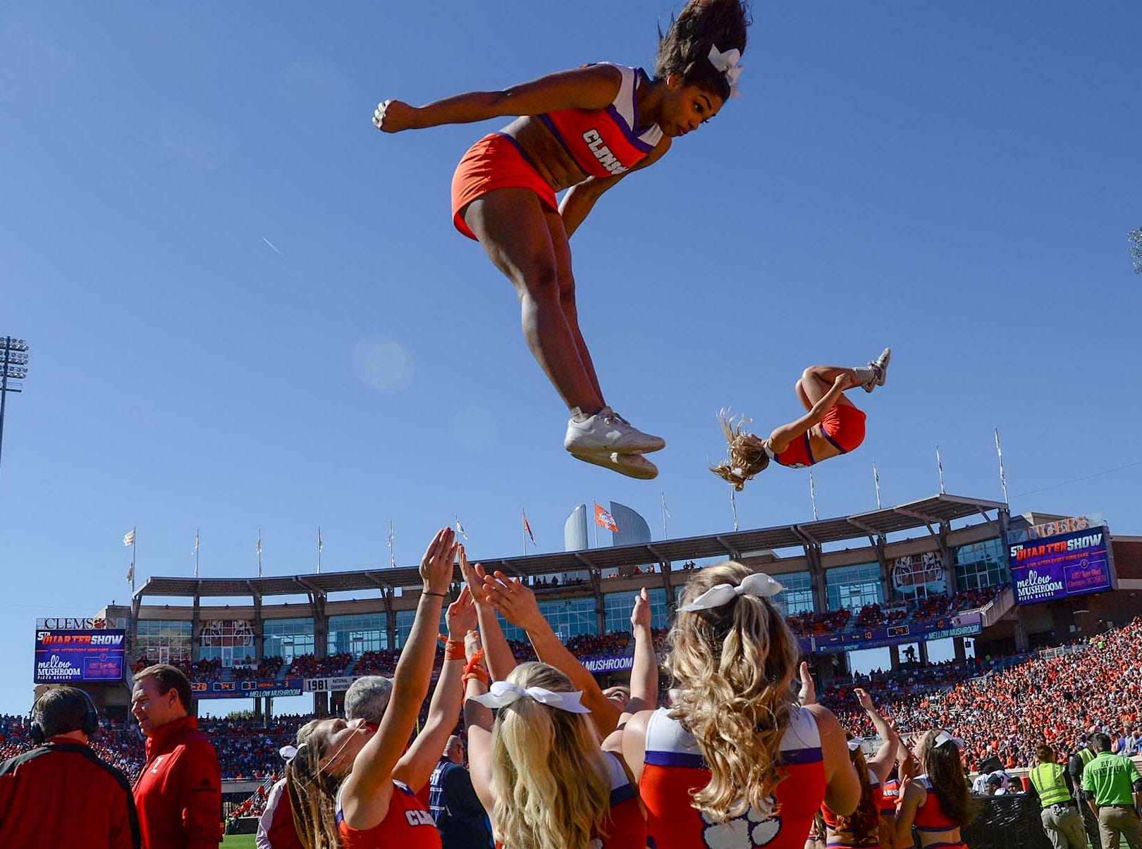 Cheerleaders are tossed in the air during the first quarter of the game with Louisville in Memorial Stadium on Saturday, November 3, 2018.
