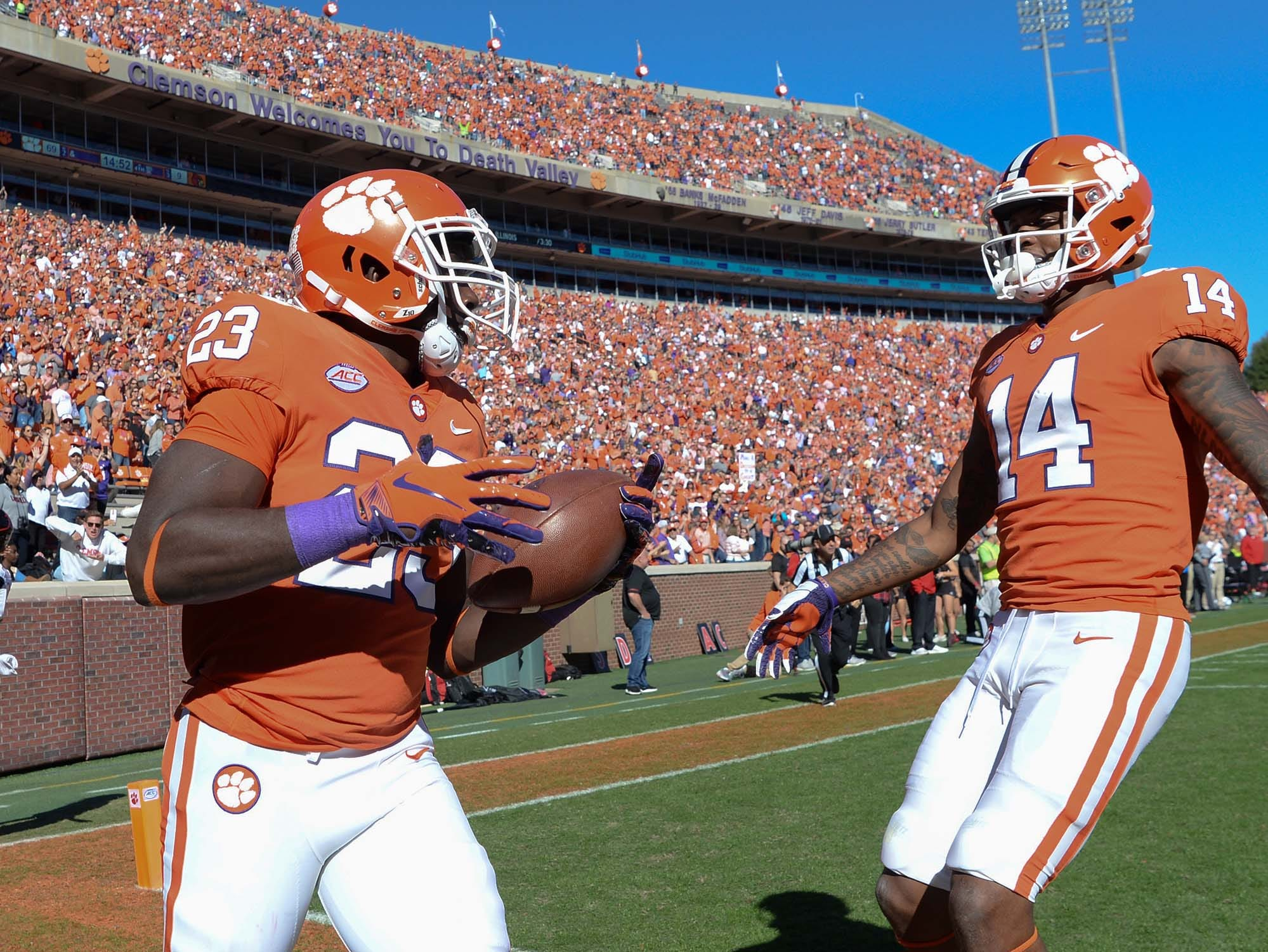 Clemson running back Lyn-J Dixon (23) scores a touchdown and celebrates with wide receiver Diondre Overton (14) during the fourth quarter in Memorial Stadium on Saturday, November 3, 2018.