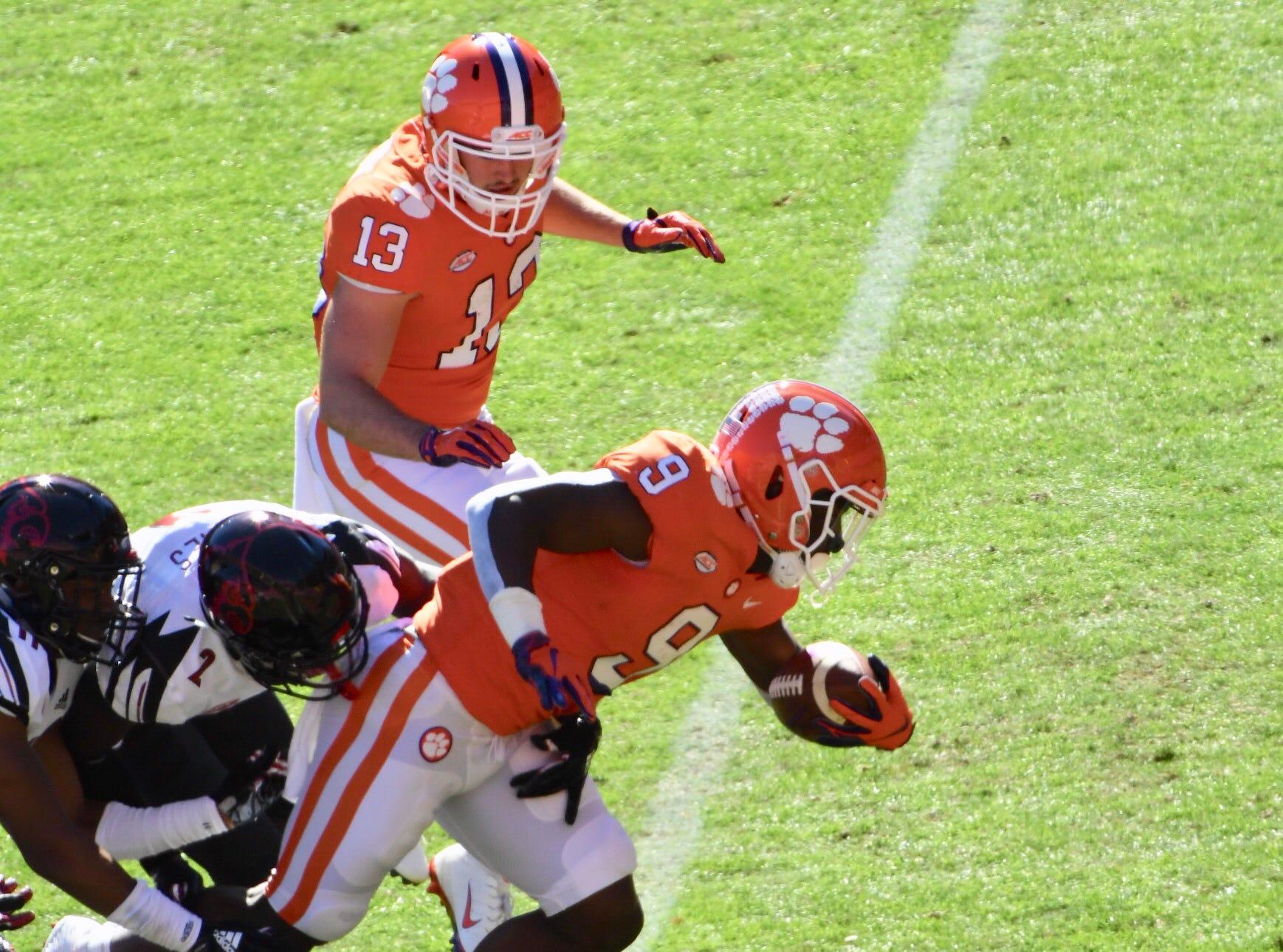 Travis Etienne scores Clemson's first touchdown against Louisville.
