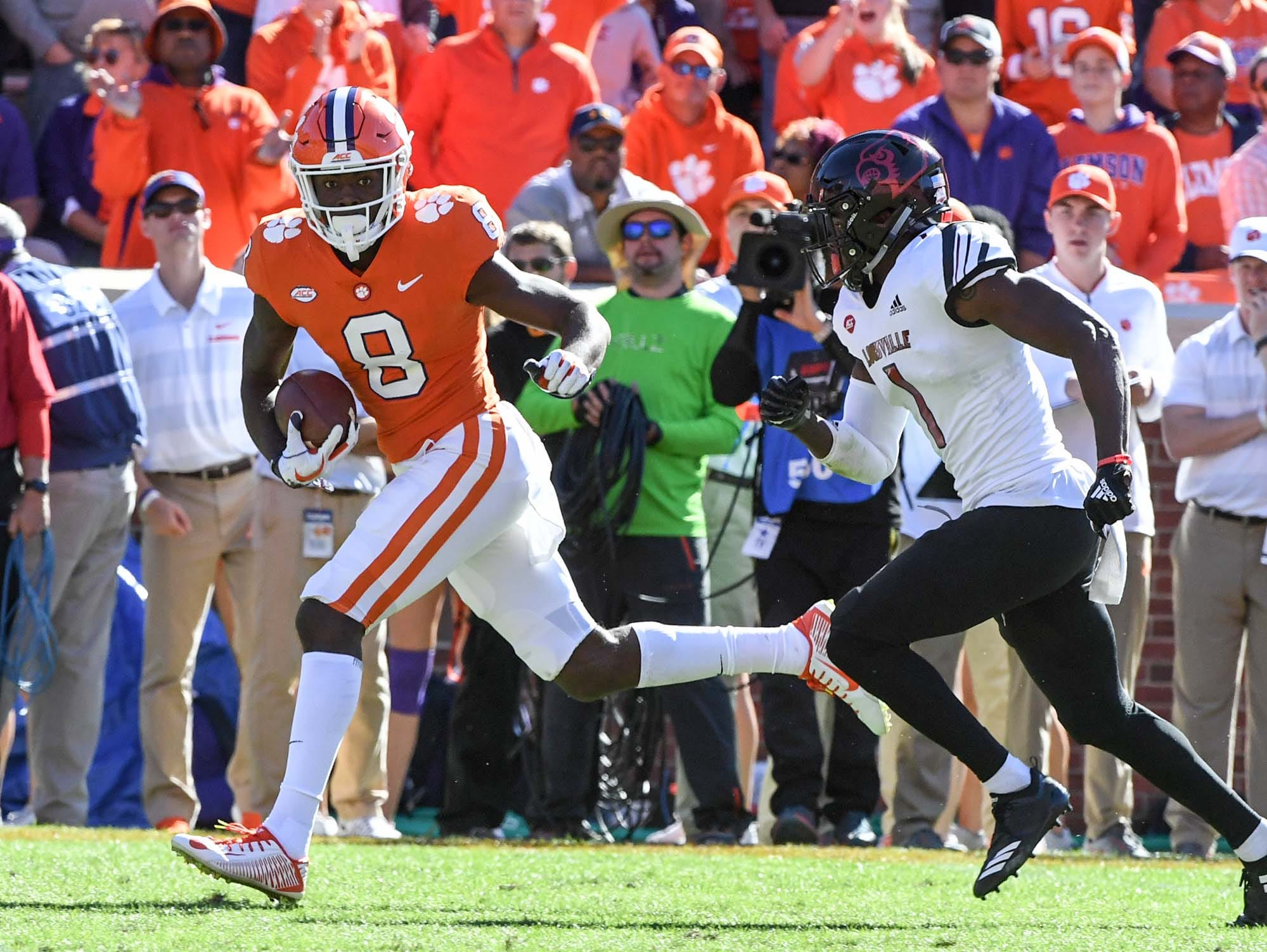 Clemson wide receiver Justyn Ross (8) runs by Louisville cornerback P.J. Mbanasor(1) for a 59-yard touchdown during the third quarter in Memorial Stadium on Saturday, November 3, 2018.