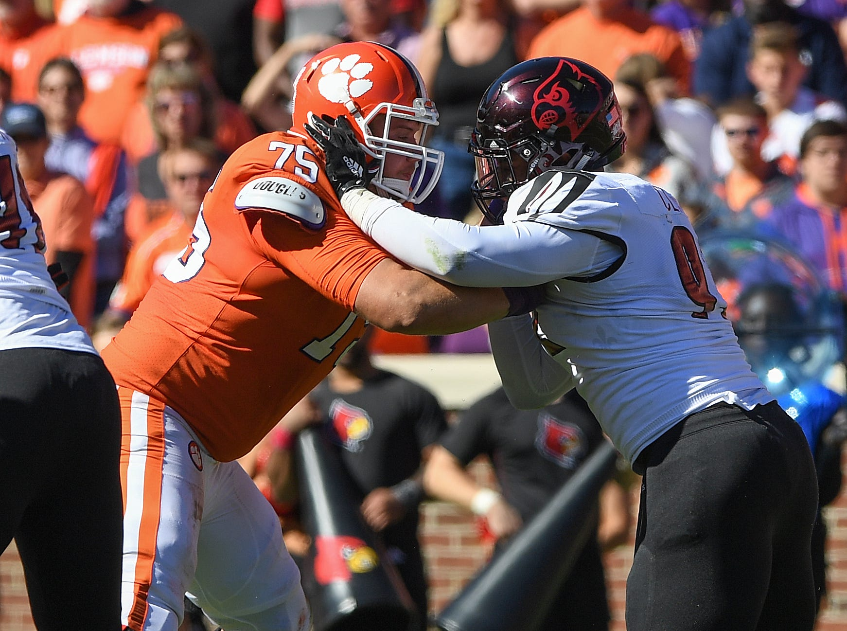 Clemson offensive lineman Mitch Hyatt (75) blocks Louisville defensive end Malik Clark (92) on a play that broke the record for most offensive plays by a Clemson player in a carrier during the 2nd quarter Saturday, November 3, 2018 at Clemson's Memorial Stadium.