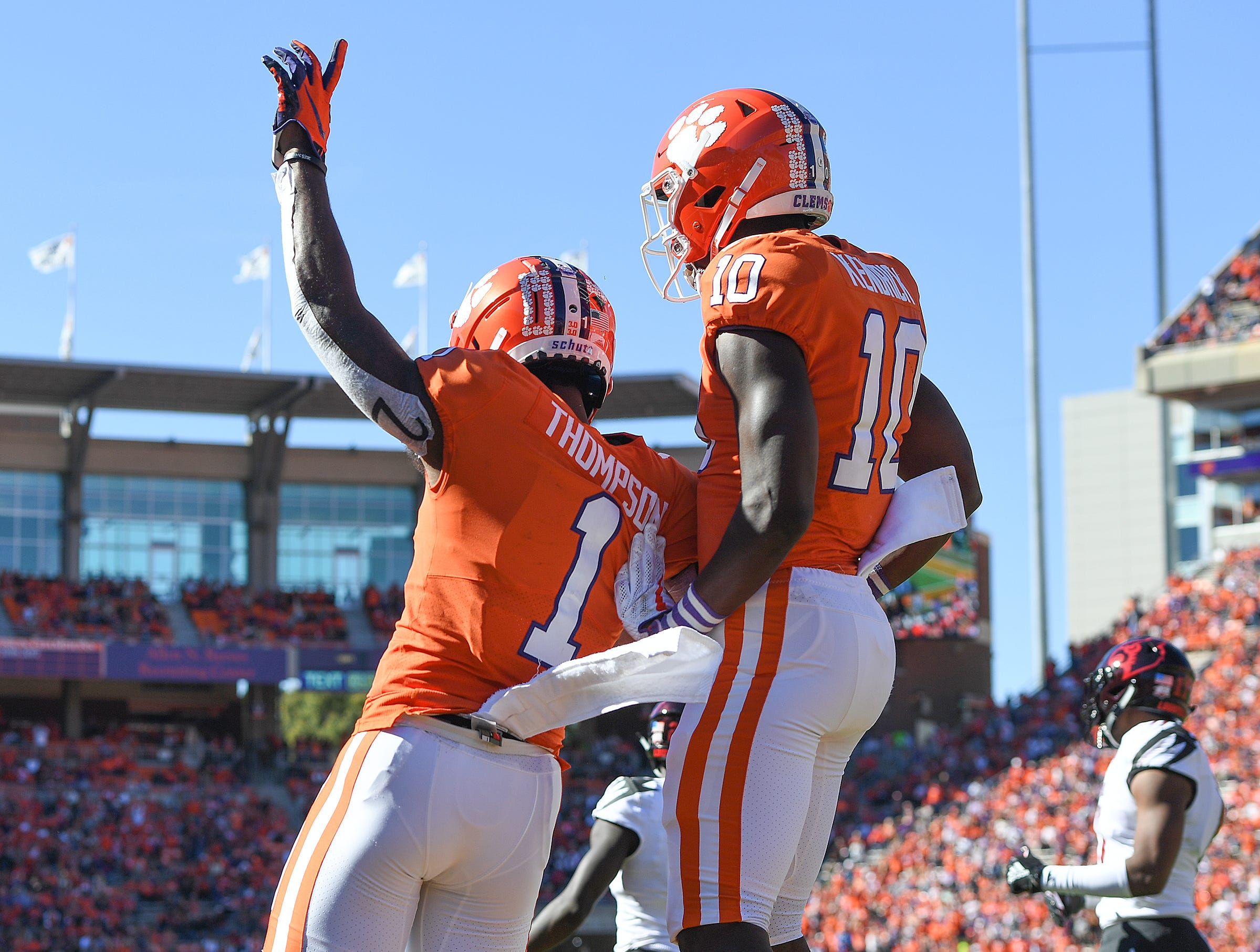 Clemson wide receiver Trevion Thompson (1) celebrates  Derion Kendrick (10) after catching a TD against Louisville during the 3rd quarter Saturday, November 3, 2018 at Clemson's Memorial Stadium.