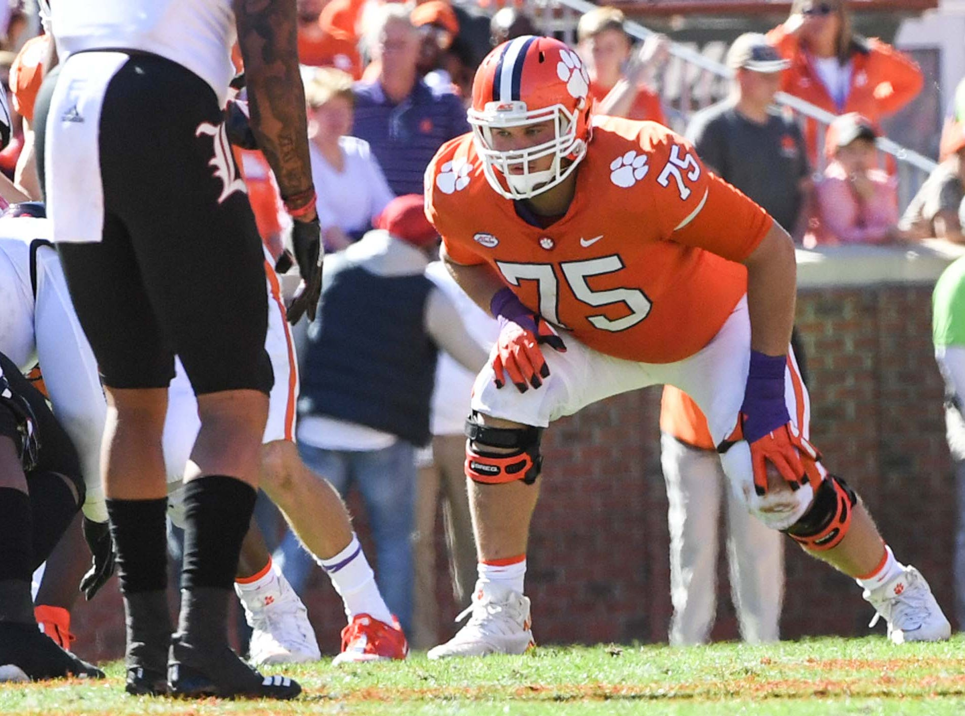 Clemson offensive lineman Mitch Hyatt (75) lines up against Louisville during the third quarter in Memorial Stadium on Saturday, November 3, 2018. Hyatt broke the record for most plays by any Clemson player in school history.