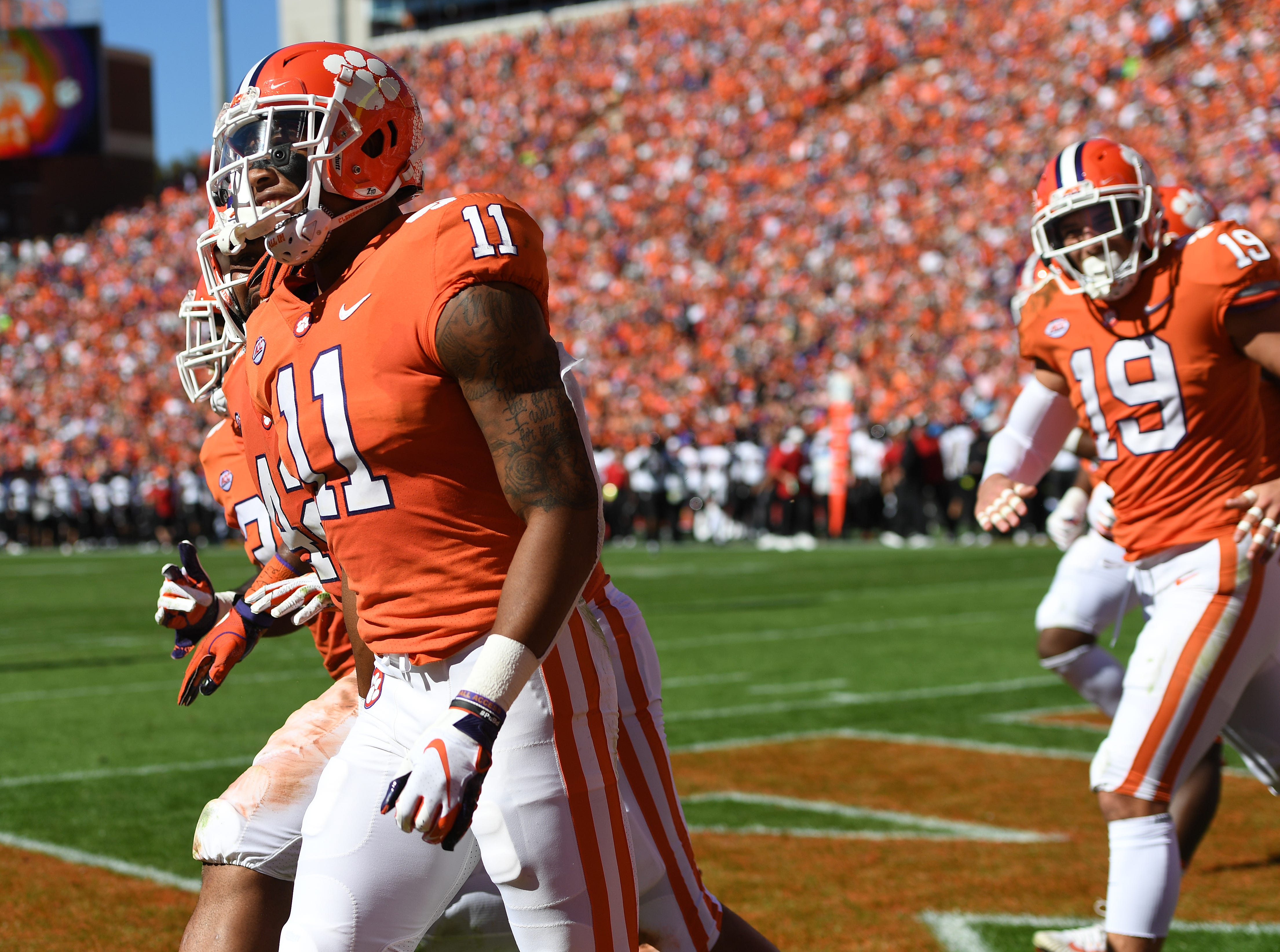 Clemson safety Isaiah Simmons (11) celebrates after retiring a Louisville interception for a TD during the 2nd quarter Saturday, November 3, 2018 at Clemson's Memorial Stadium.